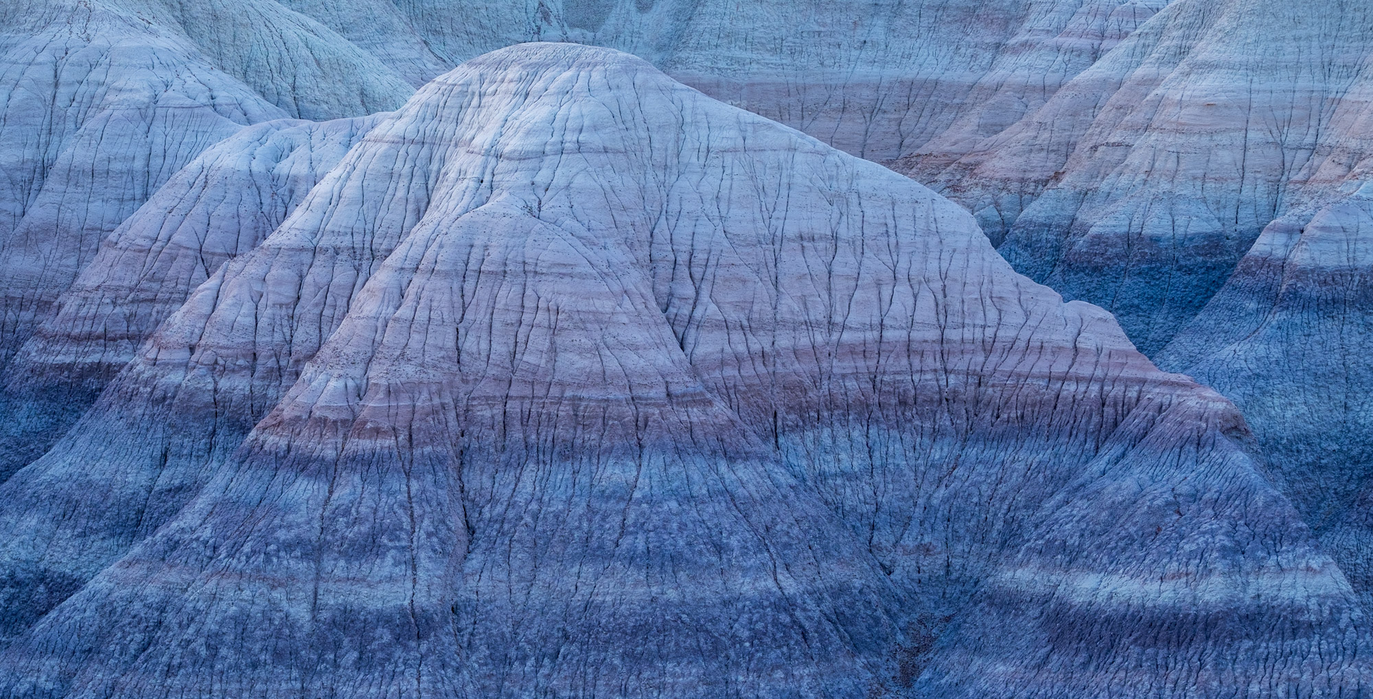 A great example of the blue hour at Blue Mesa and how it makes the striations in the hills very blue.