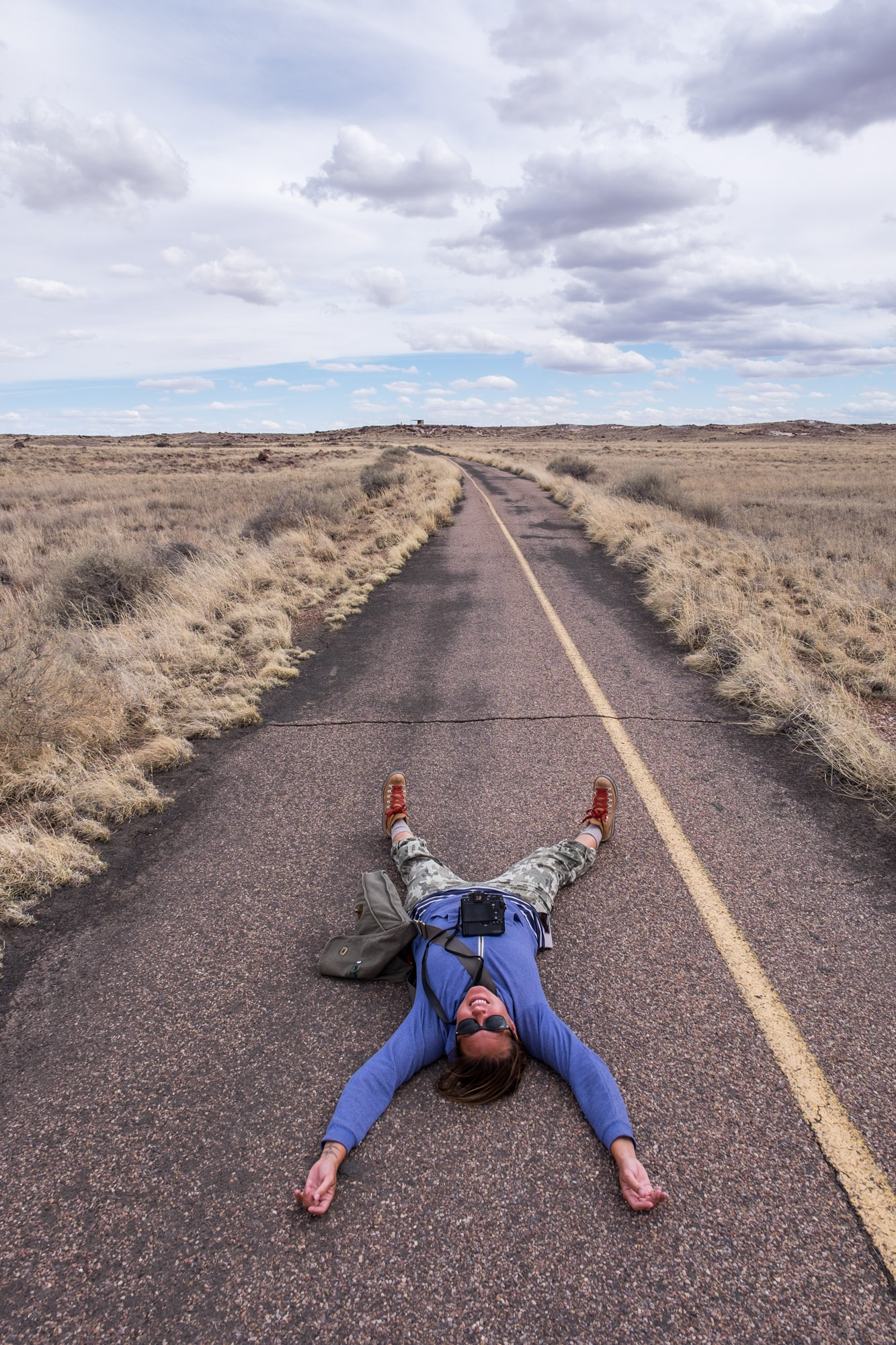 Stef loved the old Route 66 road so much, she decided to lay right down. I think she is trying to hear the rumble of old cars on the road.
