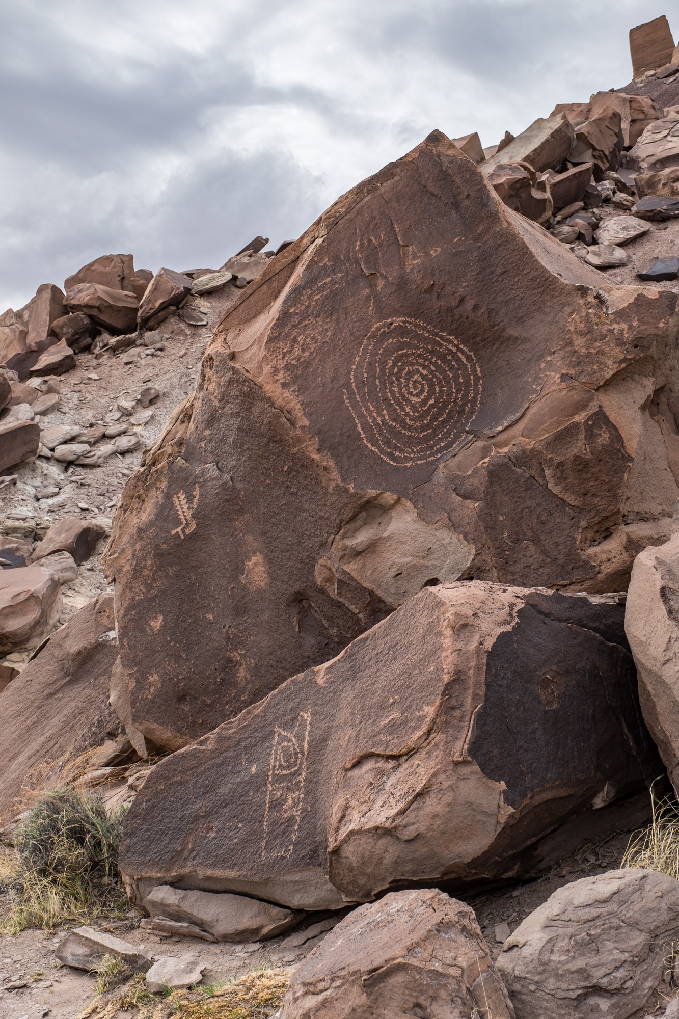 This sun petroglyph is perfectly cut in half by light and shadow at the equinoxes. Amazing.