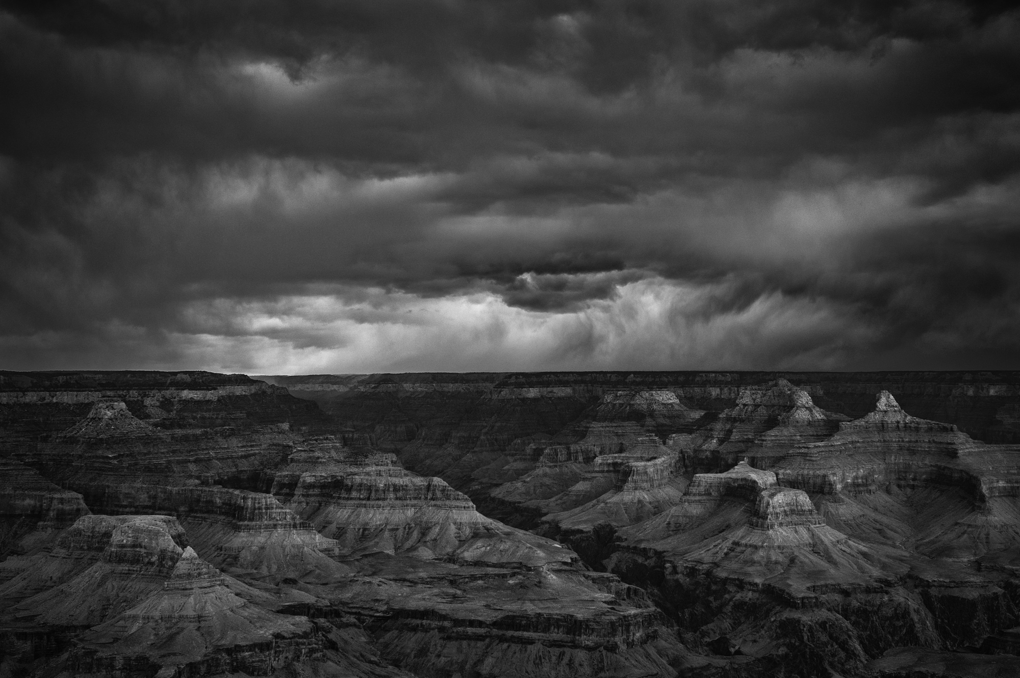 There was so much character and interest in the clouds during the storm, I thought they would look great in black and white. Very moody.