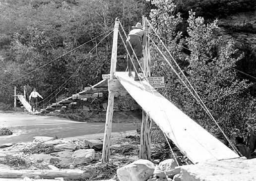 Love this cool old photo! Mr. Arthur Newton Pack, of Nature Magazine, taking motion picture of Mr. Brian on suspension bridge in front of Zion Lodge c. 1929. Copyright George A. Grant / Zion National Park