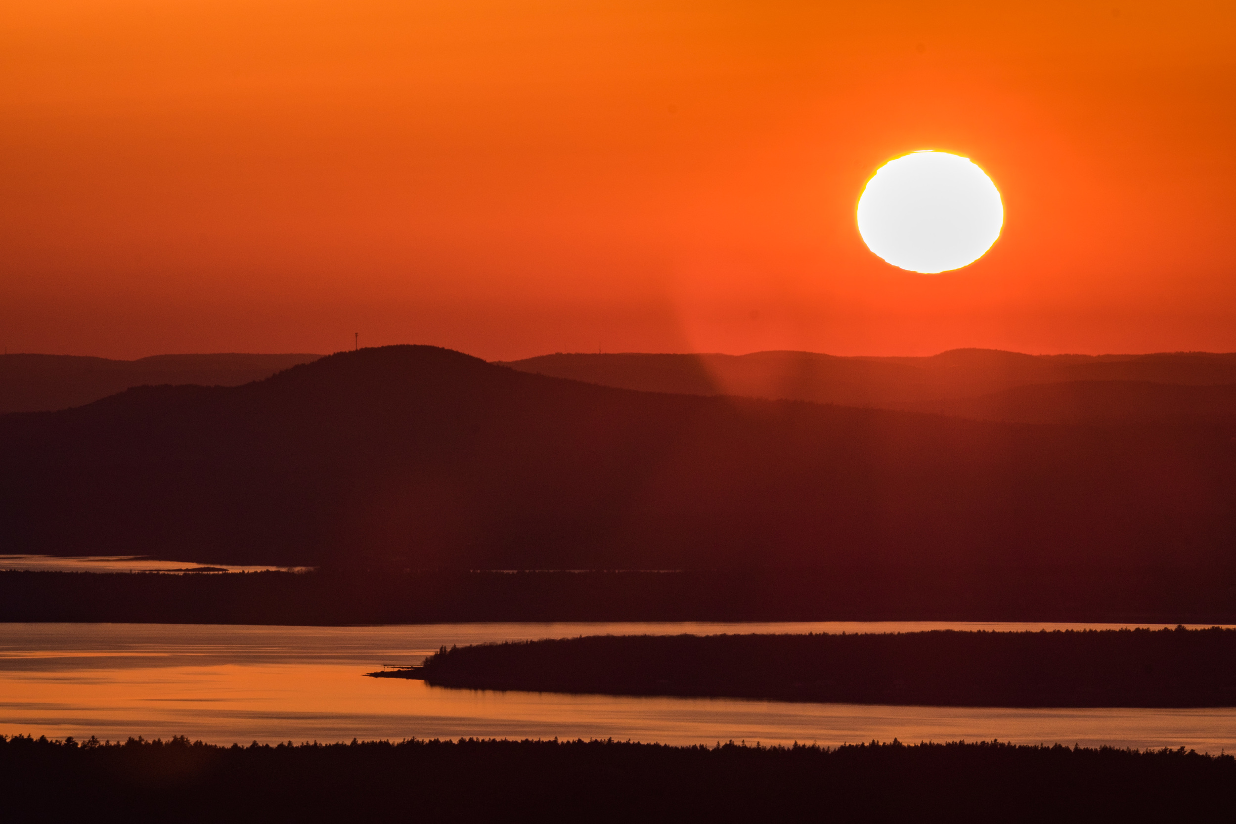 The sun sets at Acadia National Park in Maine.
