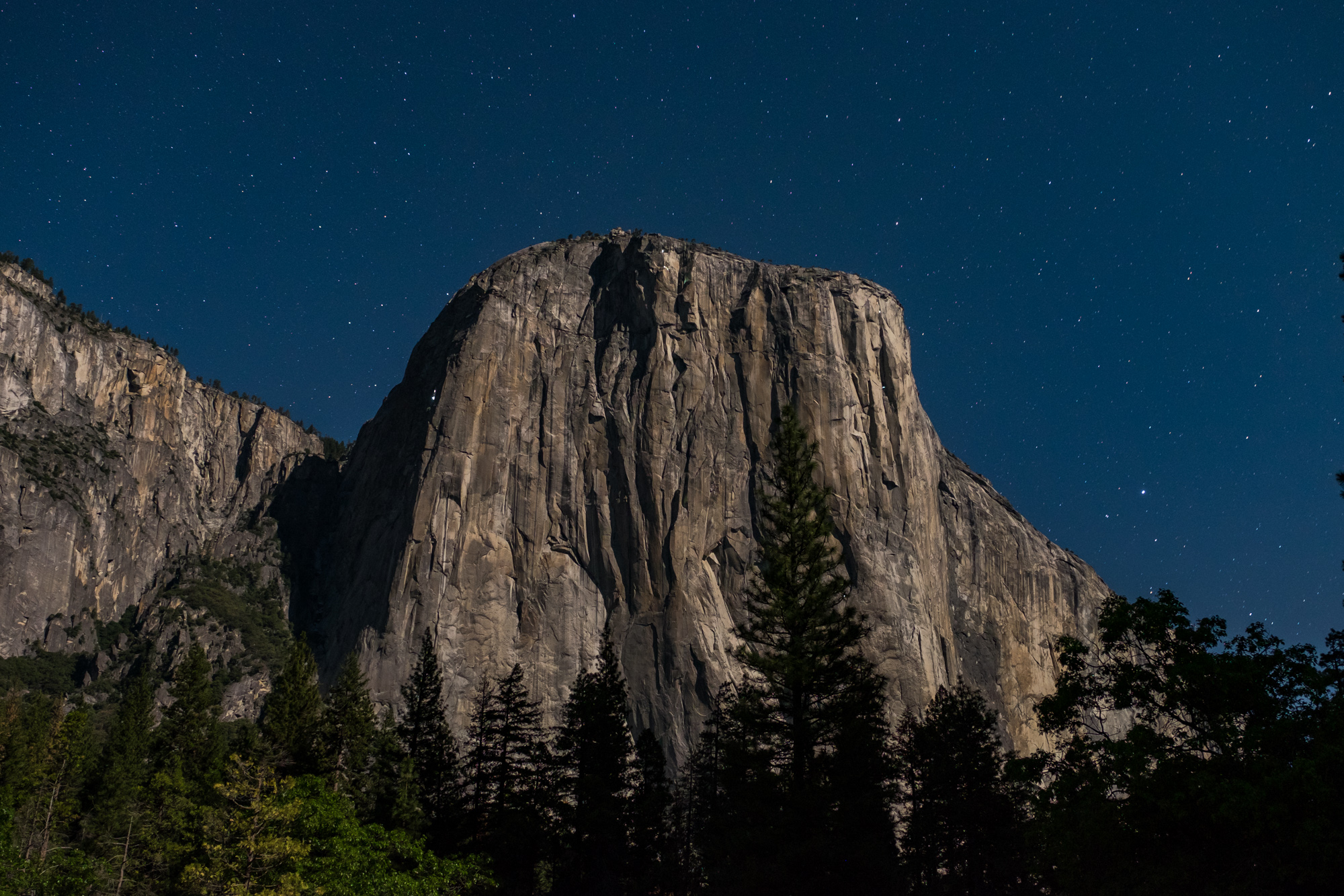 At night, the lights of the climber's on El Capitan light up like the stars in the sky. Can you see them?