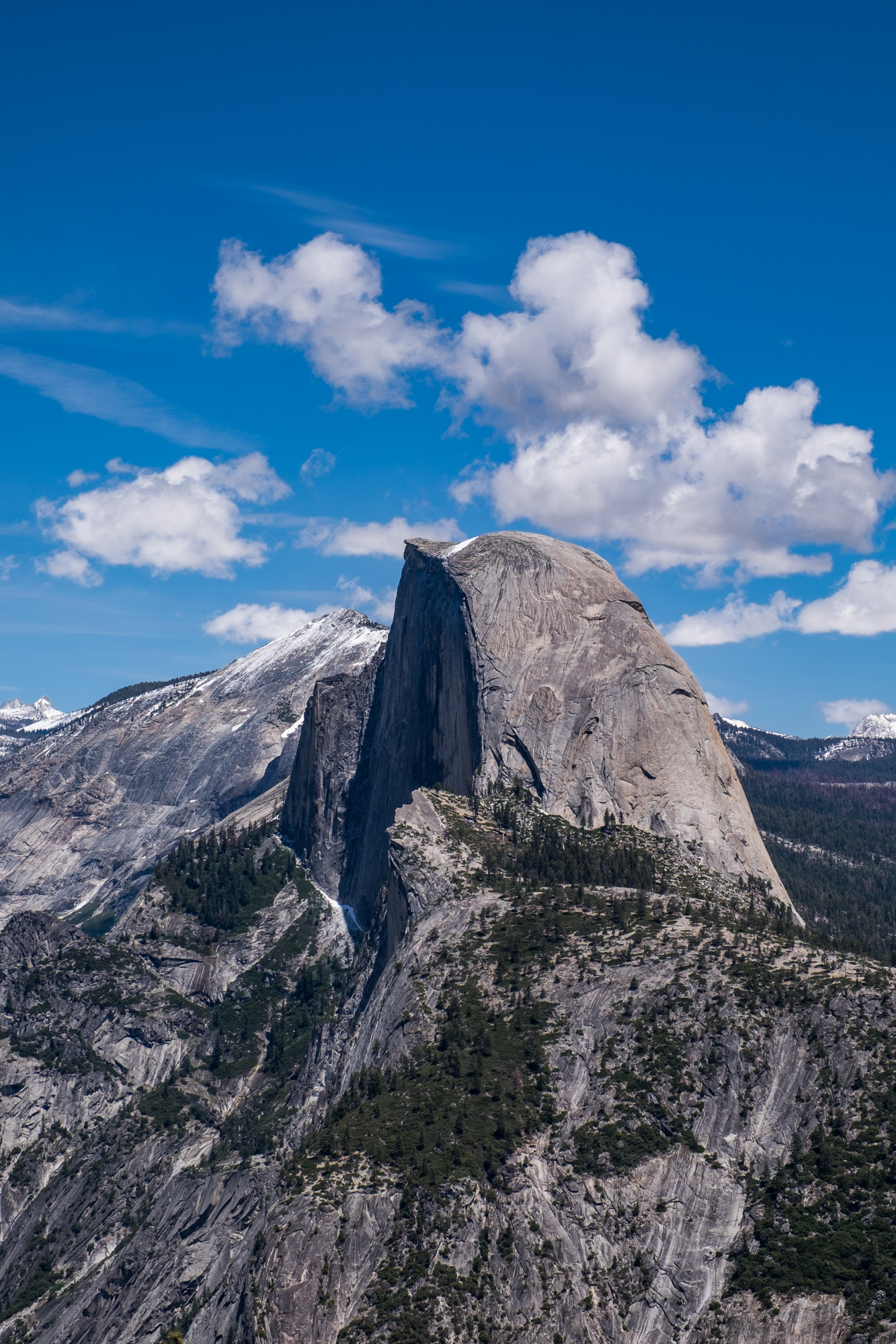 A view of Half Dome from Glacier Point on a sunny day.