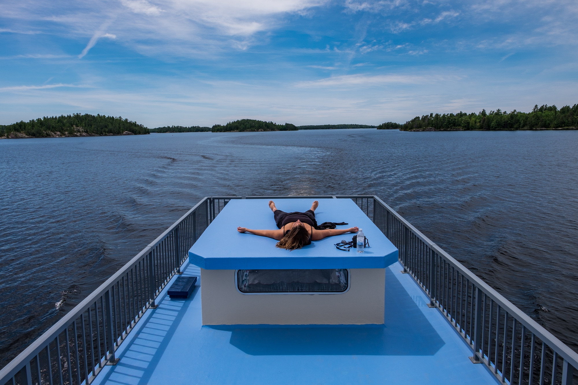Stef fully enjoying lazy days on the roof deck of the houseboat.