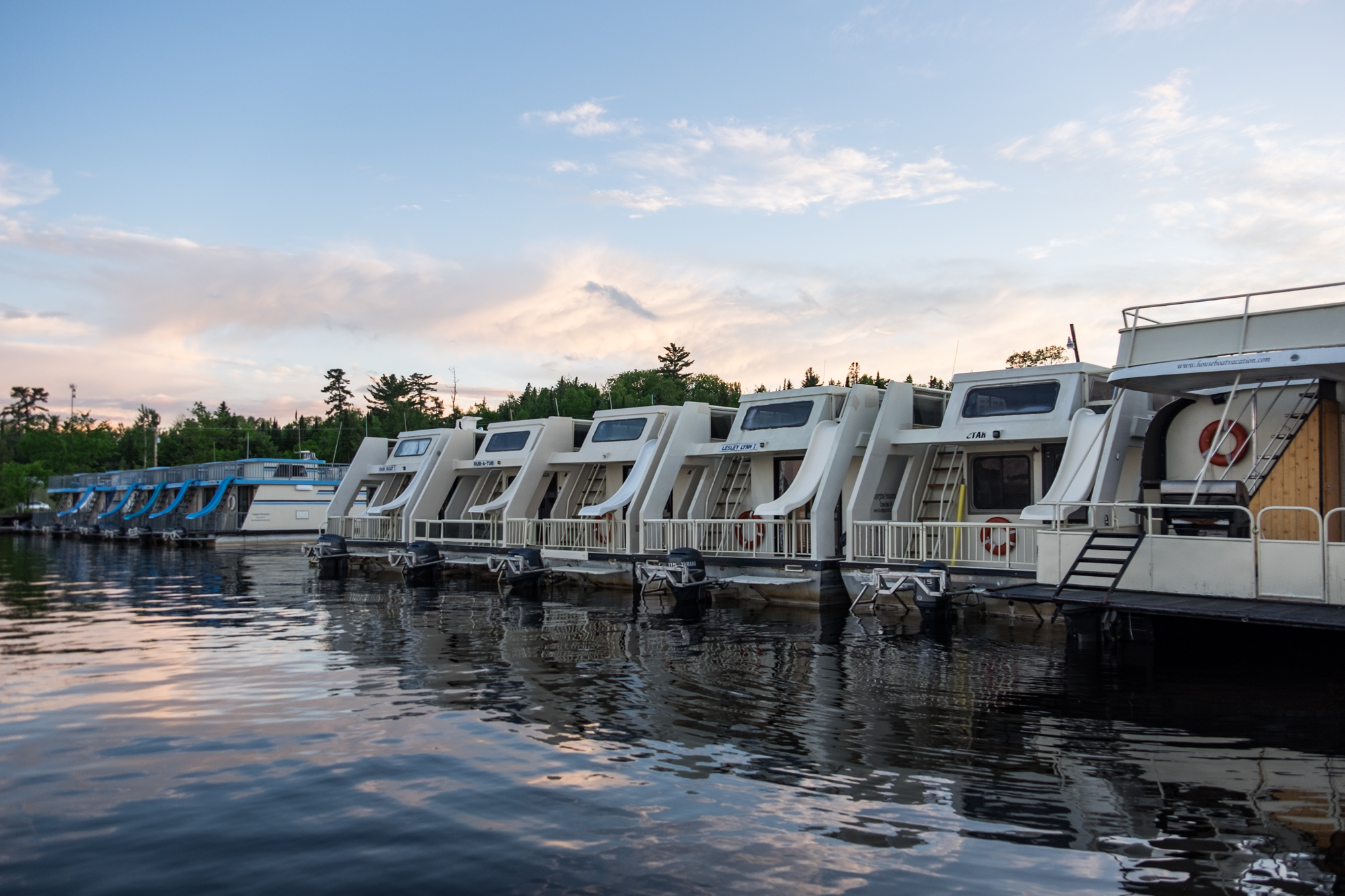 A row of houseboats await the summer crowds.