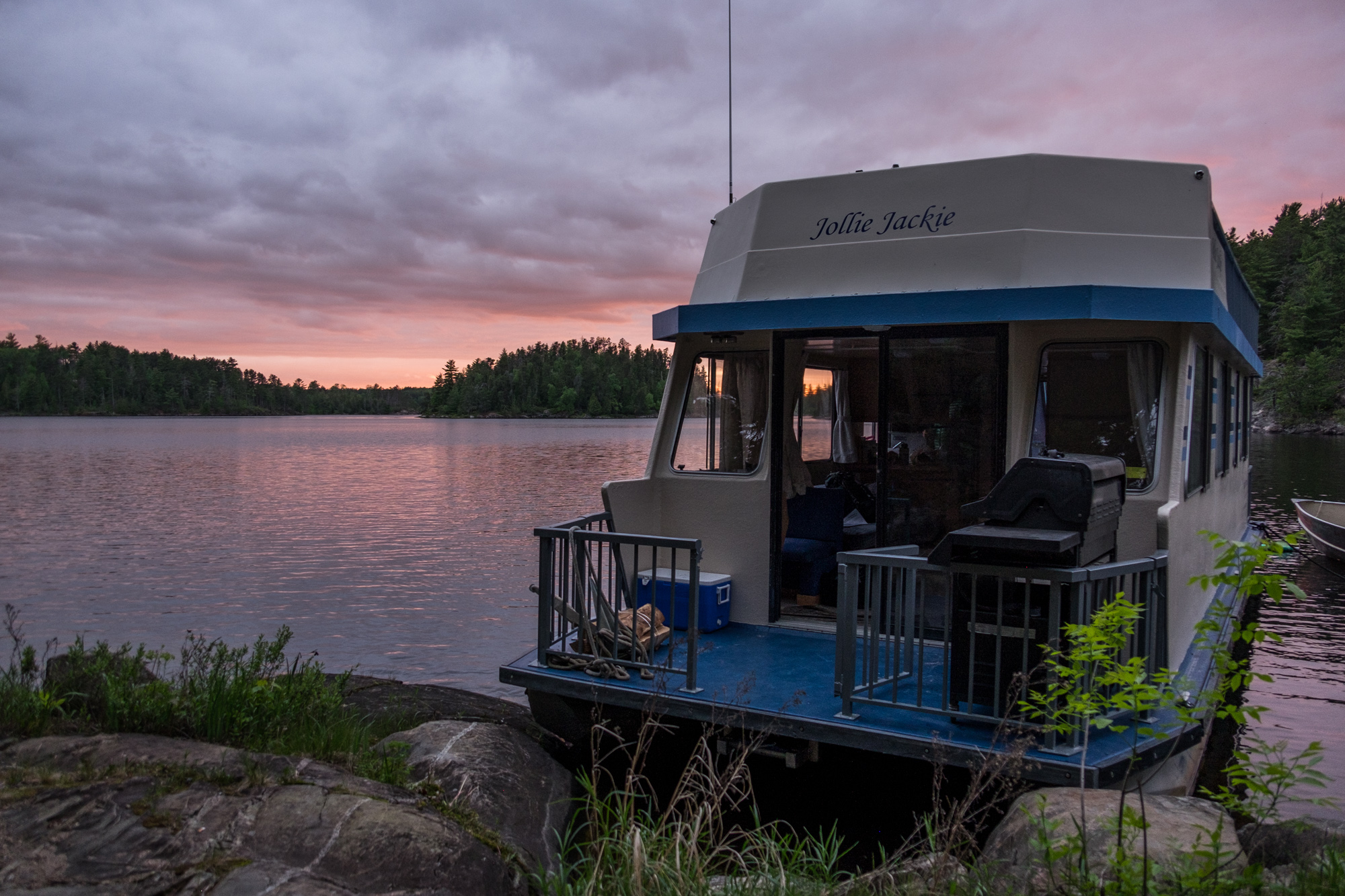 """Our houseboat, the """"Jollie Jackie"""", docked on the snake island campsite."""