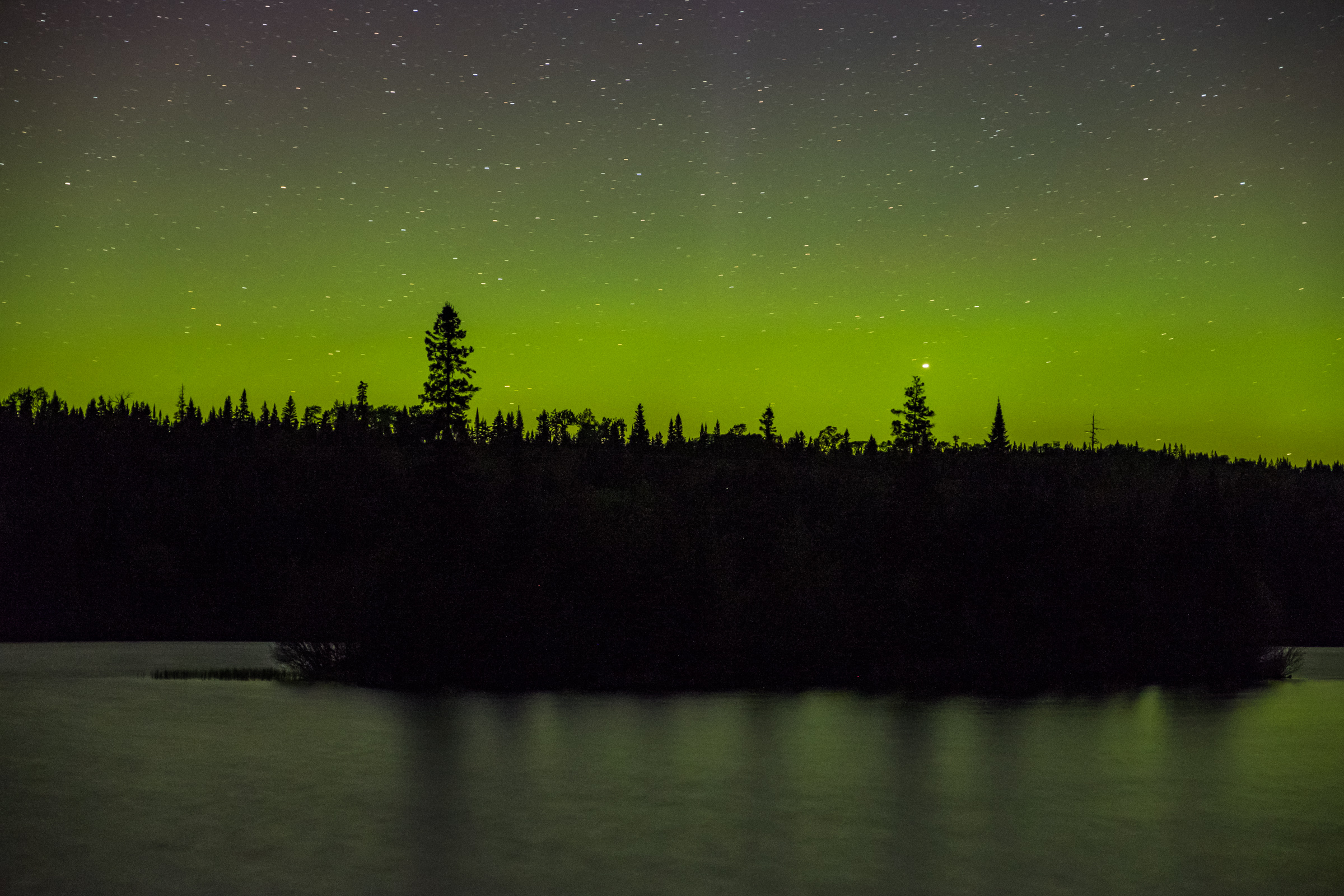 The glow of the Aurora Borealis (Northern Lights) in Isle Royale in Michigan.