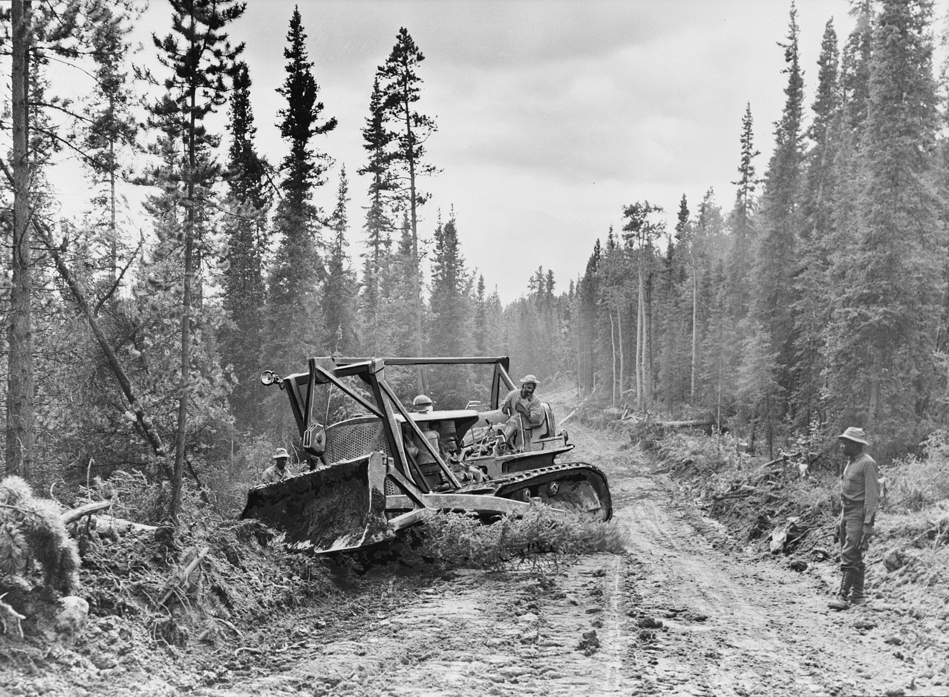 The roadway is widened in 1942 with a caterpillar tractor. Credit: Wikipedia.