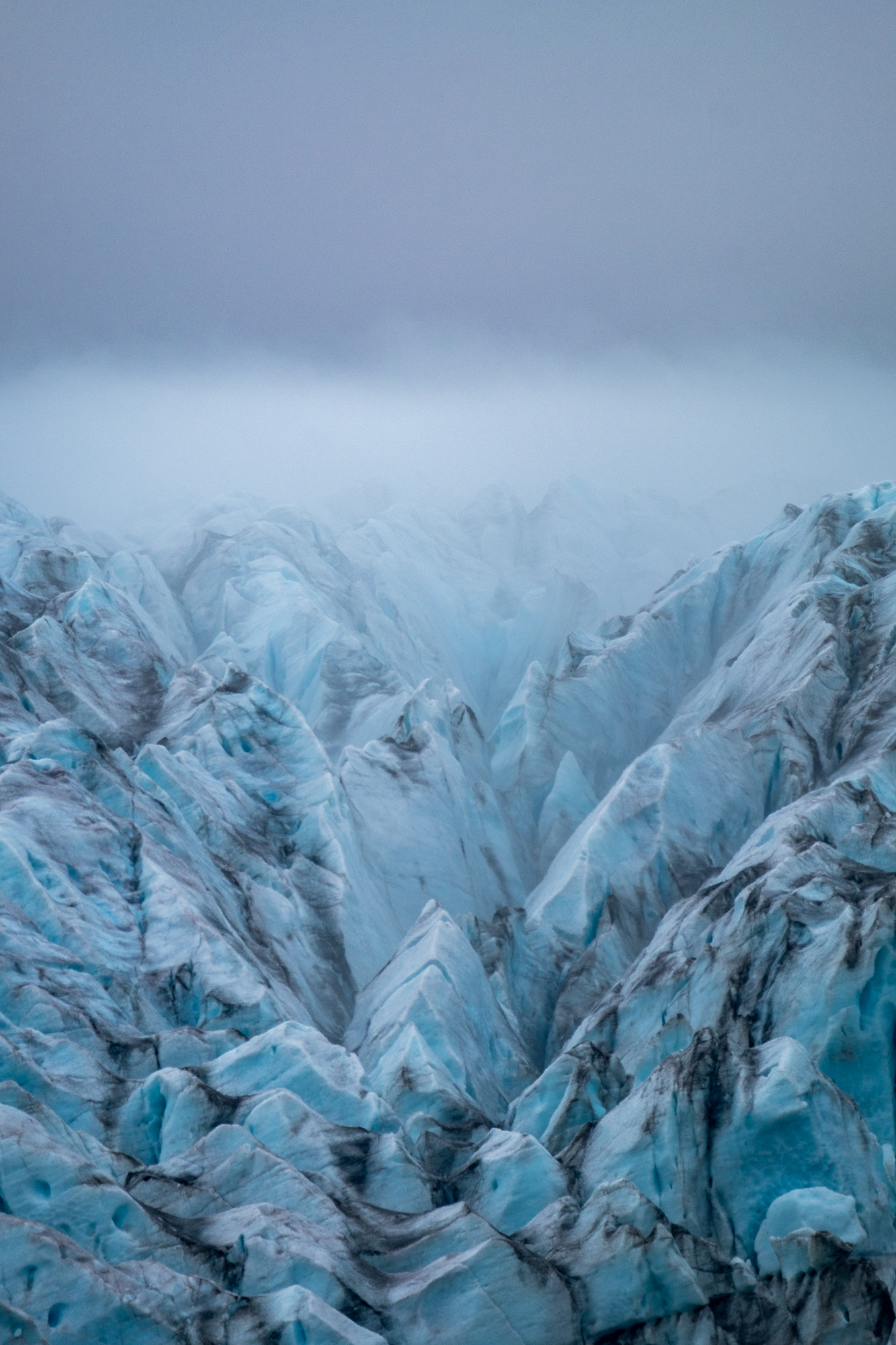 Wind picked up on the glacier, and brought the fog in.
