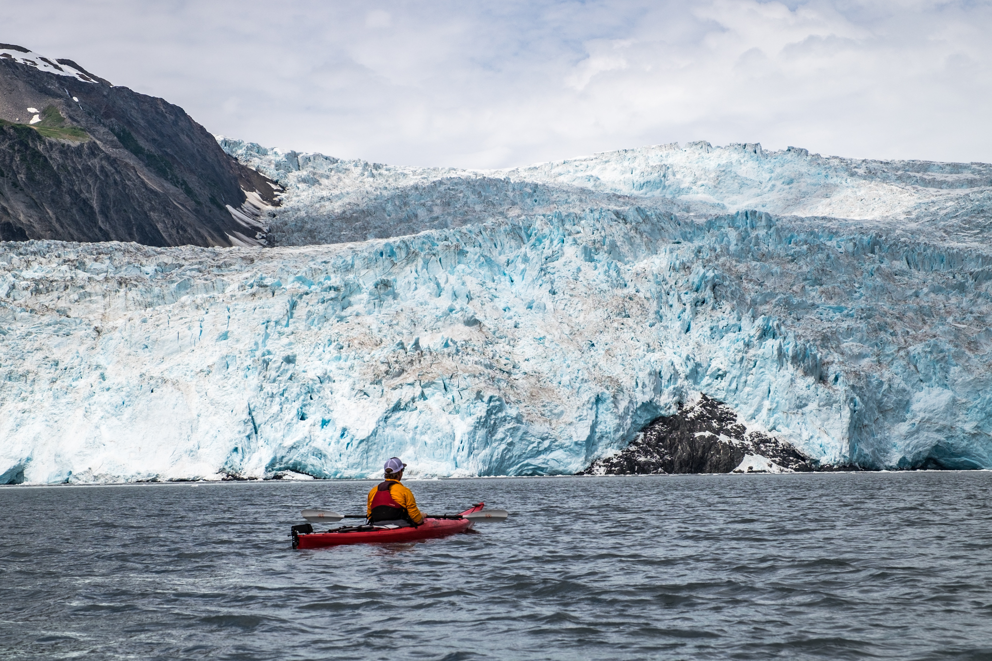 Kayaking next to the Aialik Glacier in Aialik Bay, one of the most active glaciers in Kenai Fjords National Park.