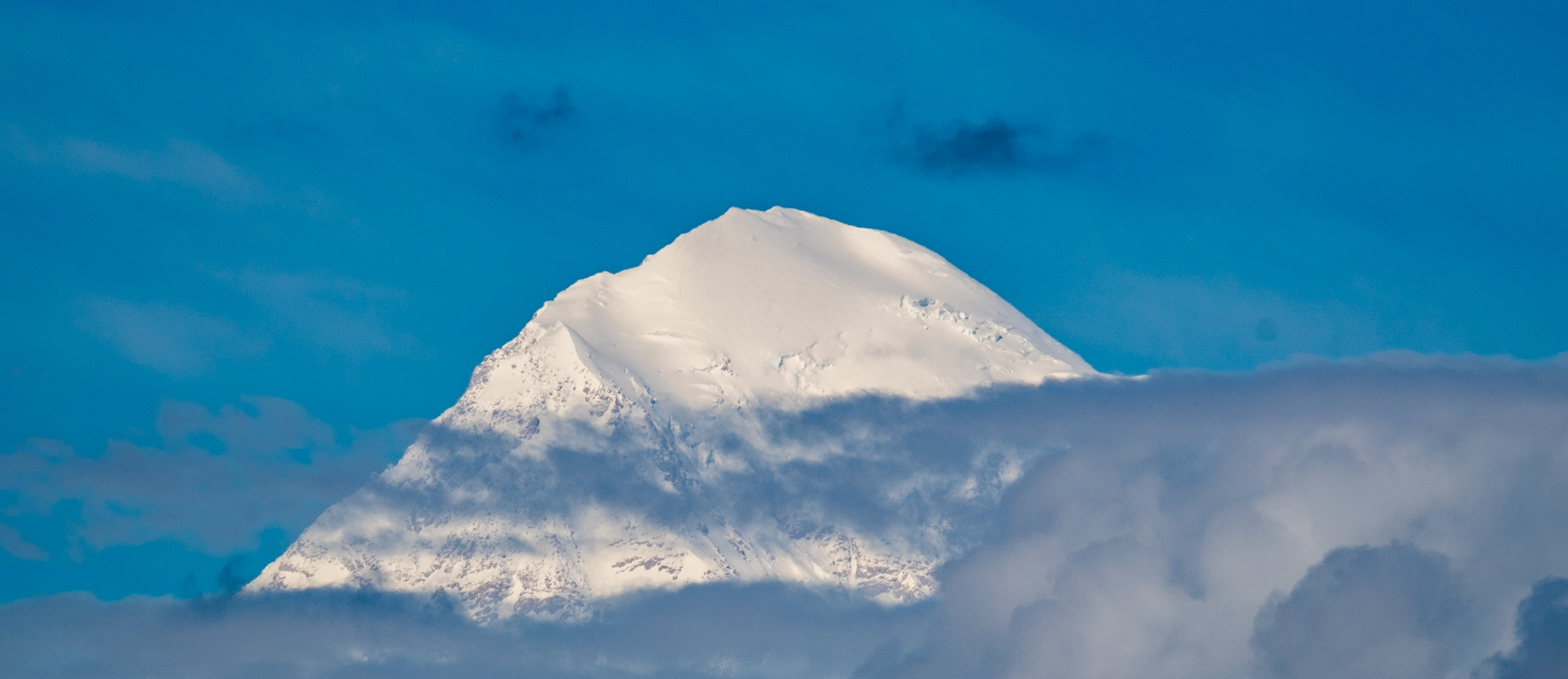 "Denali, meaning ""The High One"" or ""The Great One"" in native Athabscan, is the highest peak in North America, standing at 20,320 feet above sea level."