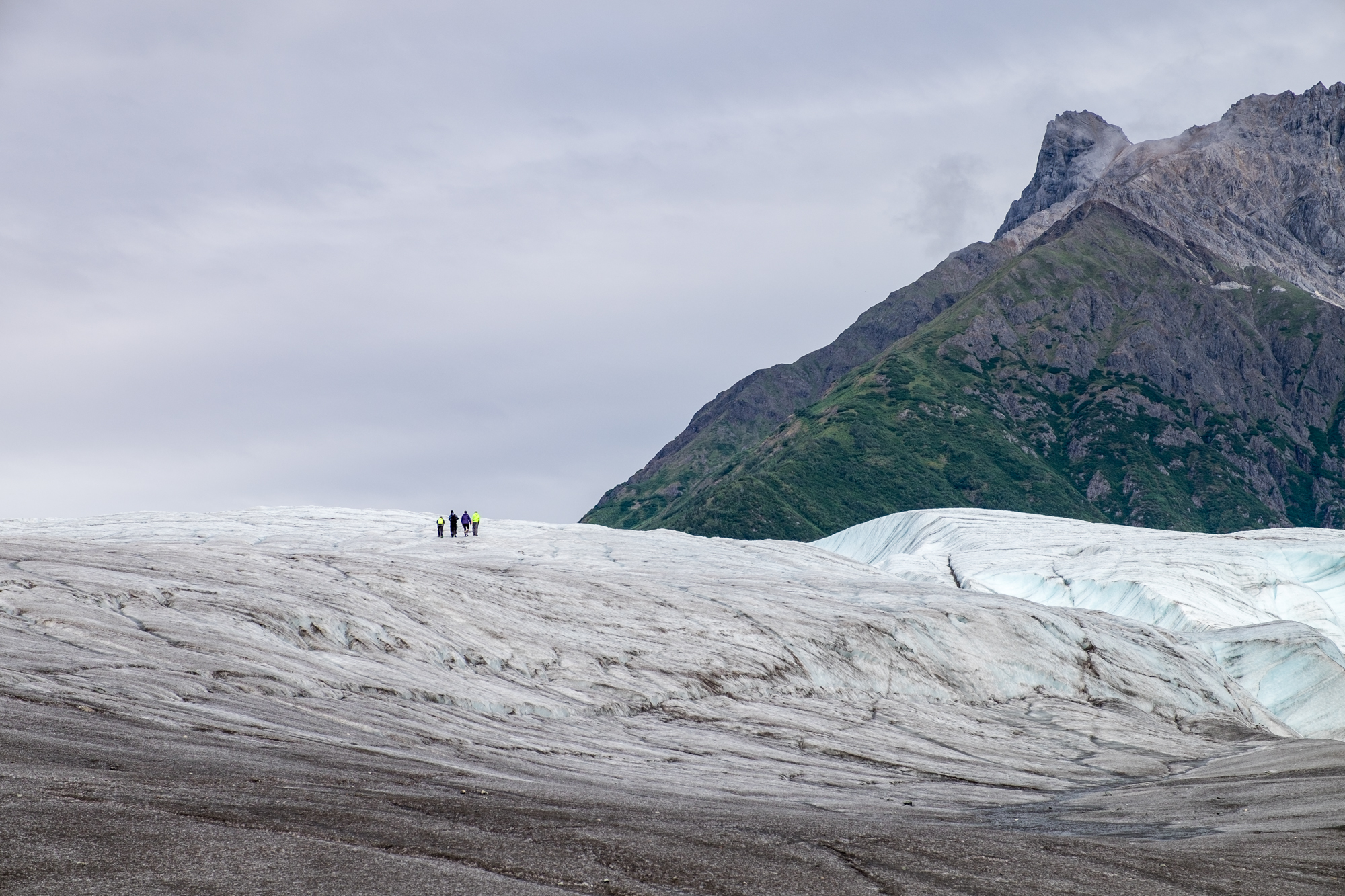 Traveling on foot across the Kennicott Glacier.