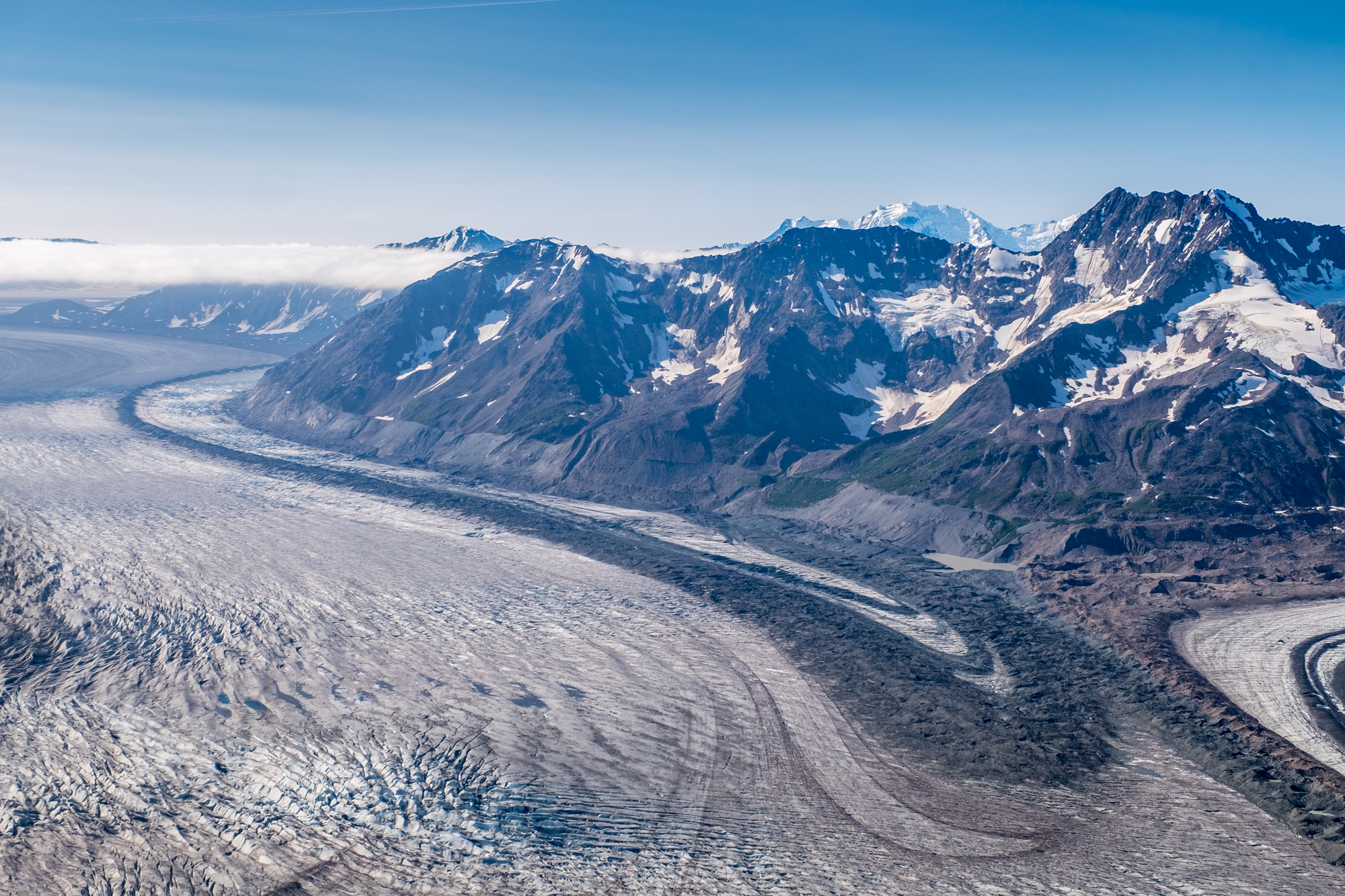 Wrangell St. Elias National Park and Preserve in Alaska from the air, shows the variety of distinct geological features that comprise this amazing region in southeast Alaska—glaciers, ice fields, alpine mountains, moraine, tundra...and that's just what you can see in this photo!