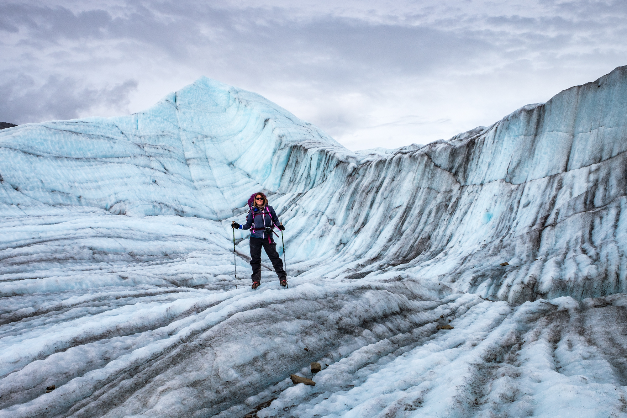 Stefanie Payne stops to pose for a shot while crossing the Root Glacier.