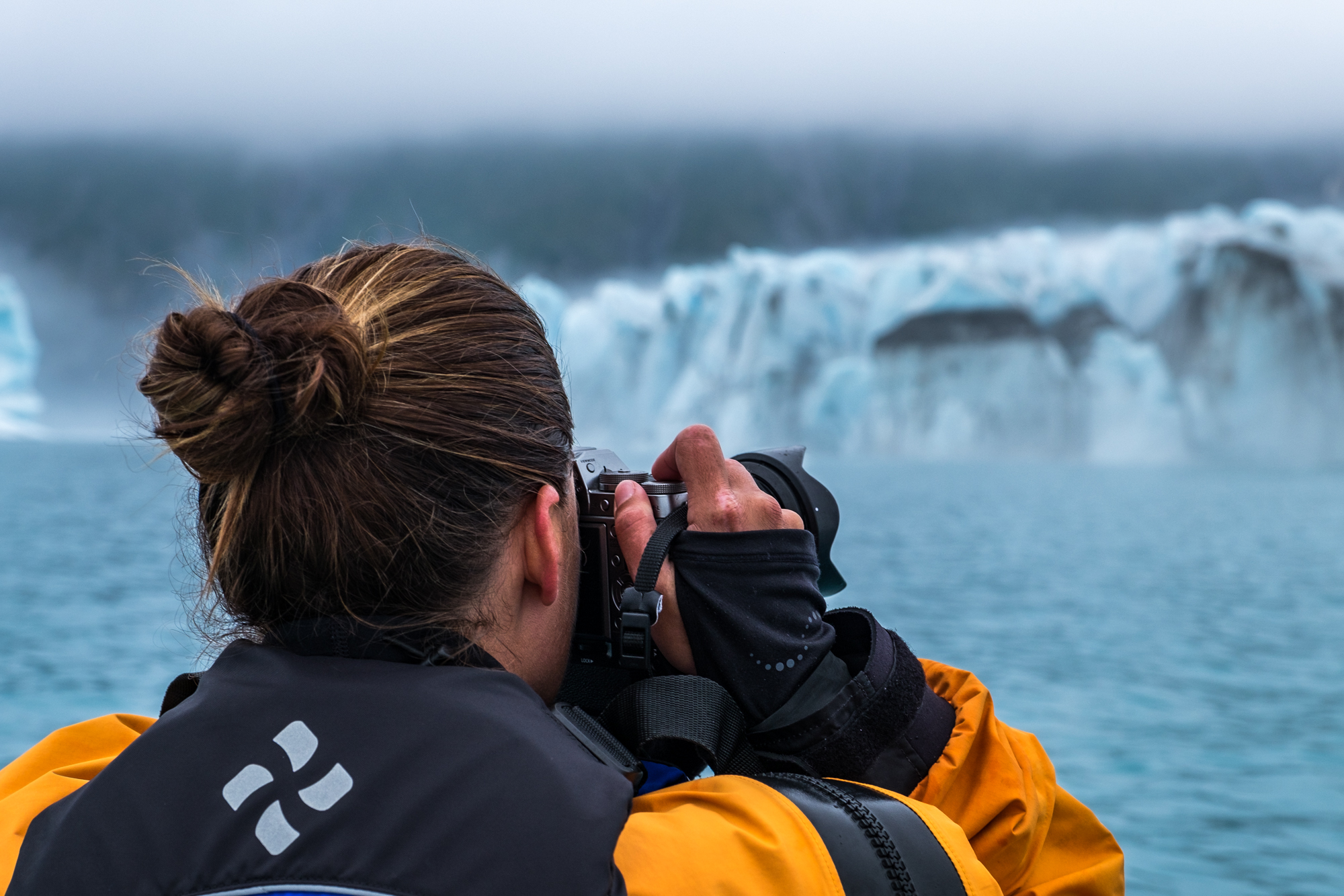 Stefanie Payne photographing icebergs in Kenai Fjords National Park with the Fujifilm X-T1.