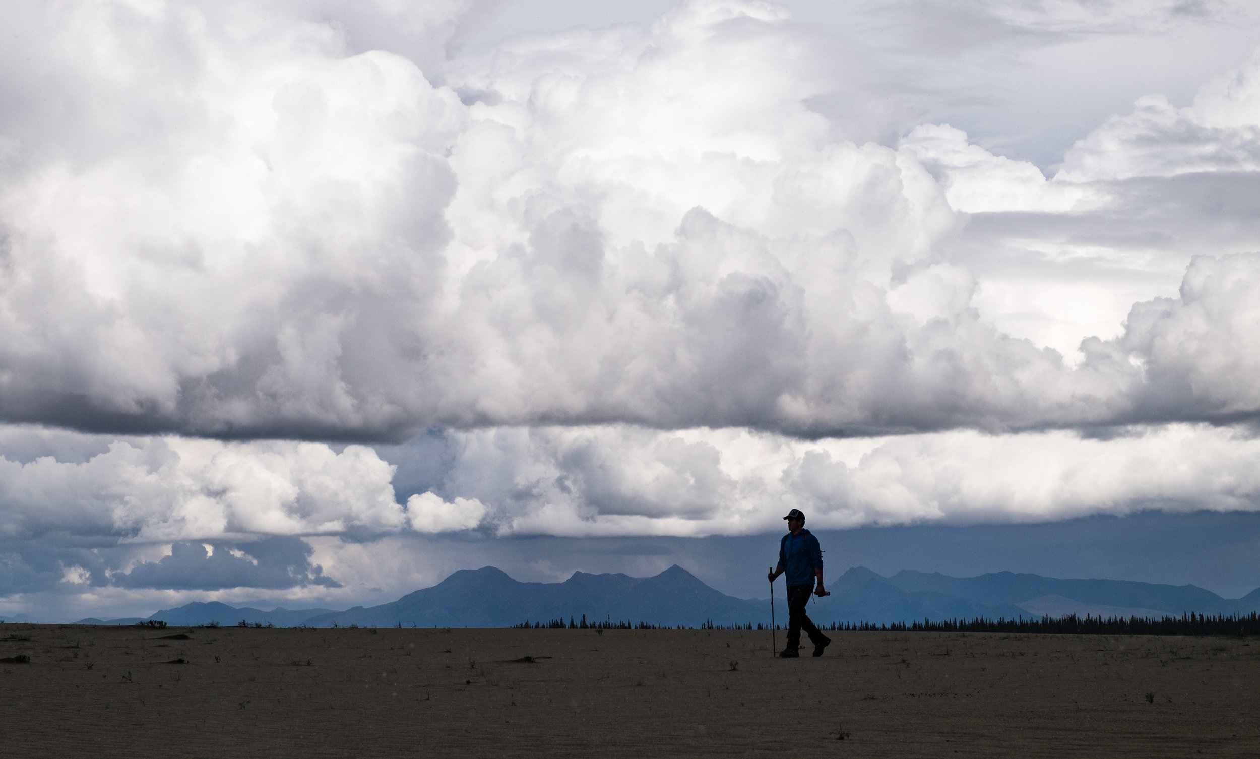 Our awesome guide, Sean, a lead guide with Alaska Alpine Adventures, silhouetted against the amazing sky.