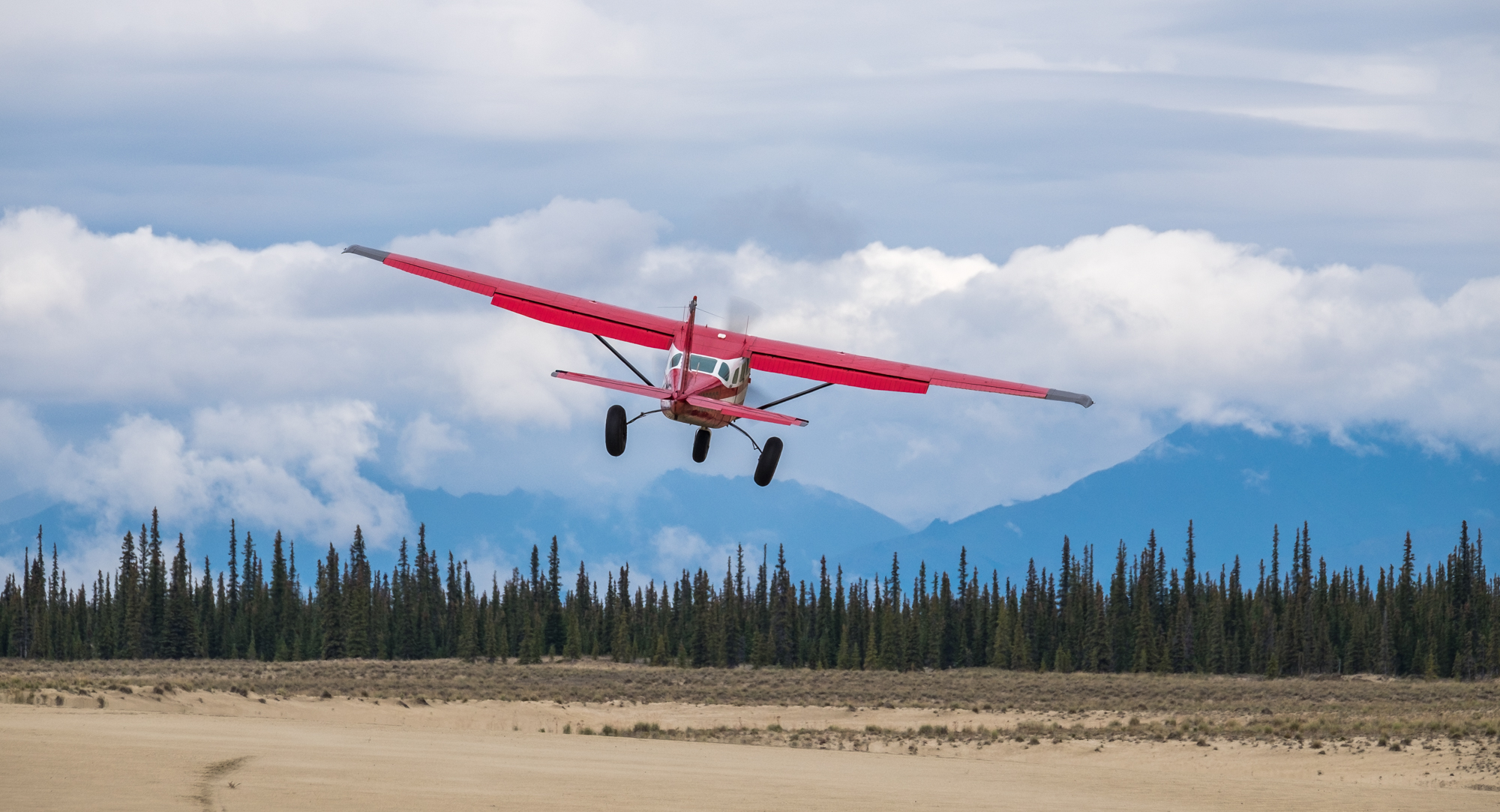Our bush plane with tundra tires takes off, leaving us with the solitude of Kobuk Valley National Park in Alaska.