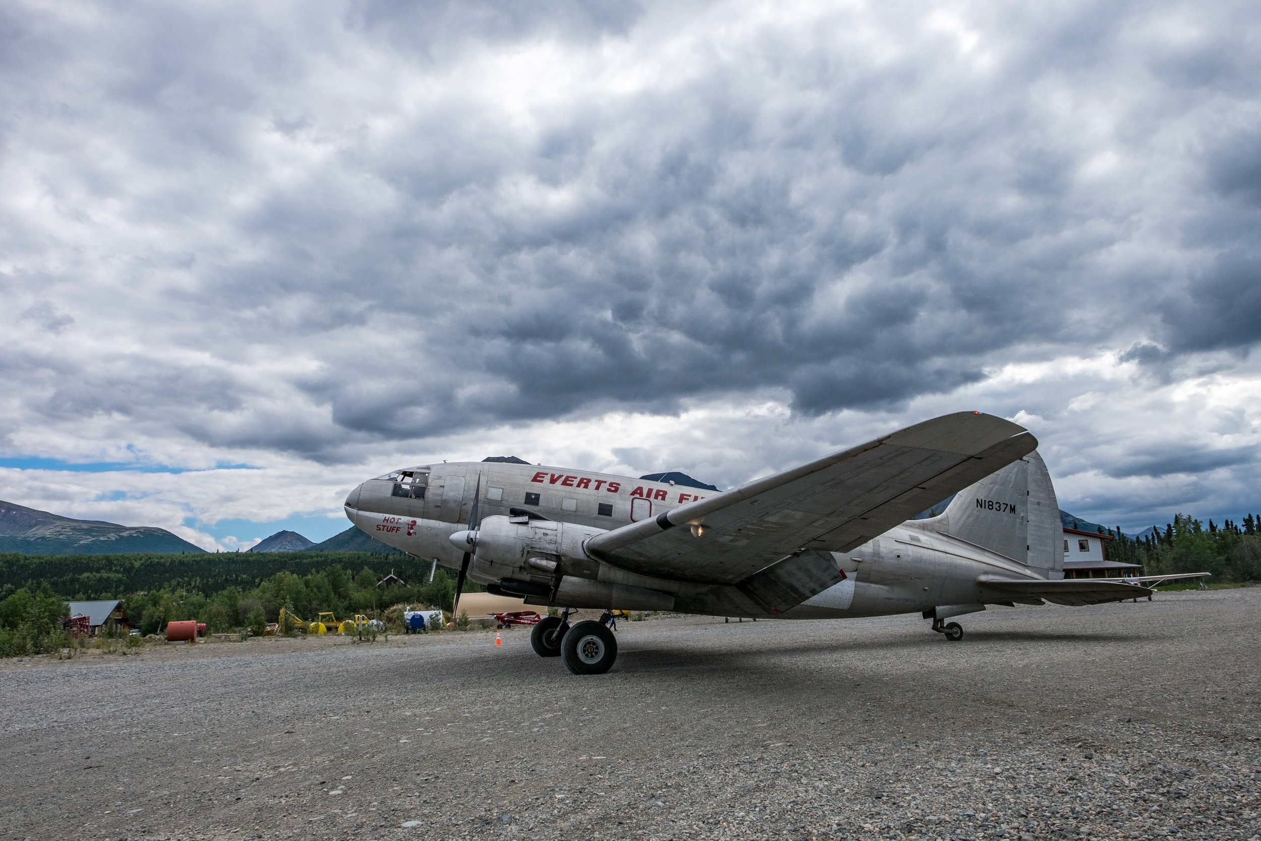 A Curtis C-46 plane lands in Port Alsworth bringing fuel to the area.