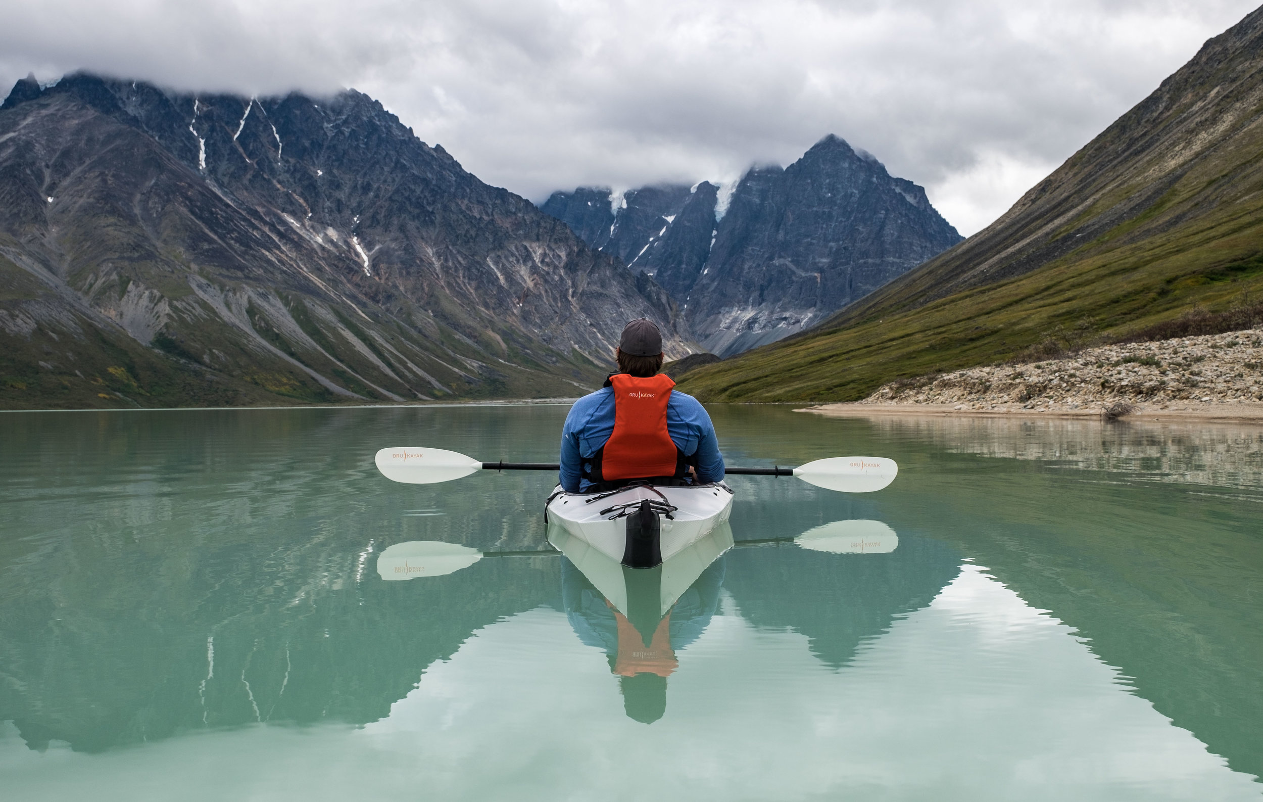Jonathan paddles off onto Turquoise Lake in his Oru origami kayak in Lake Clark's backcountry.