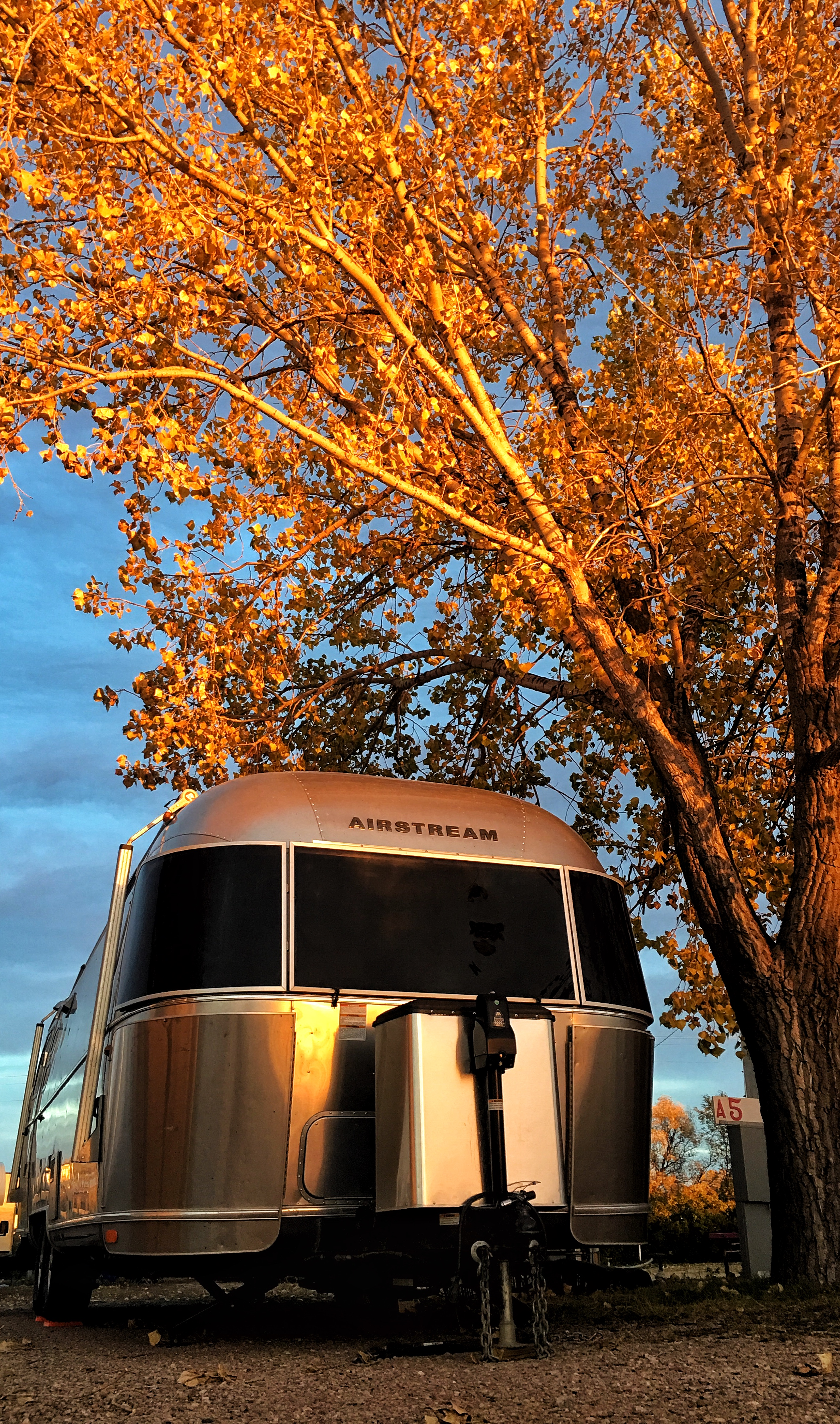 Wally the Airstream under the golden sun in Badlands National Park in beautiful South Dakota. Photo credit: Stefanie Payne