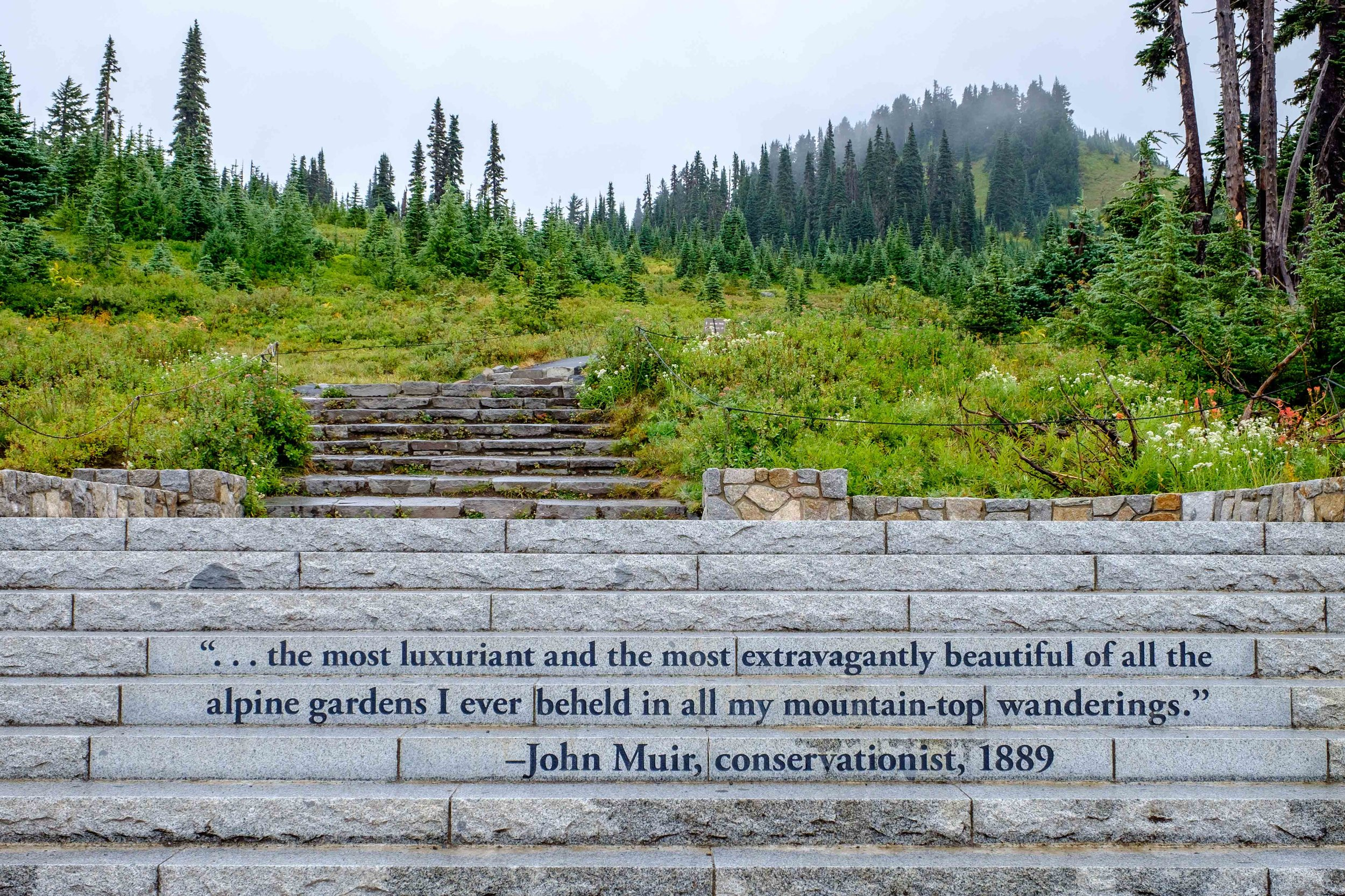 The entrance to Skyline Trail from the steps leading away from the Paradise Jackson Visitor Center is commemorated by touching words by John Muir.