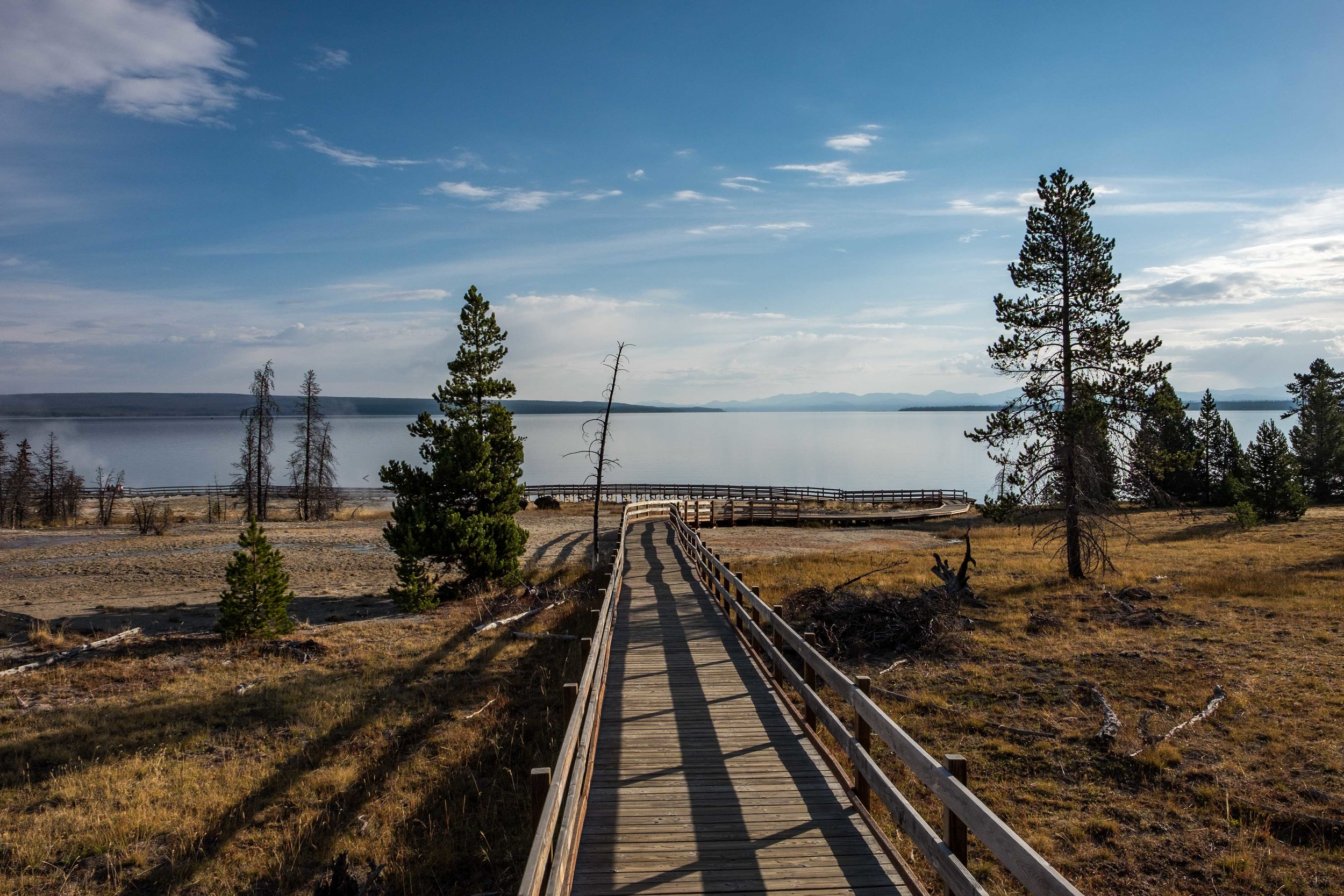 The trail leading down to the lakeside West Thumb Geyser Basin.