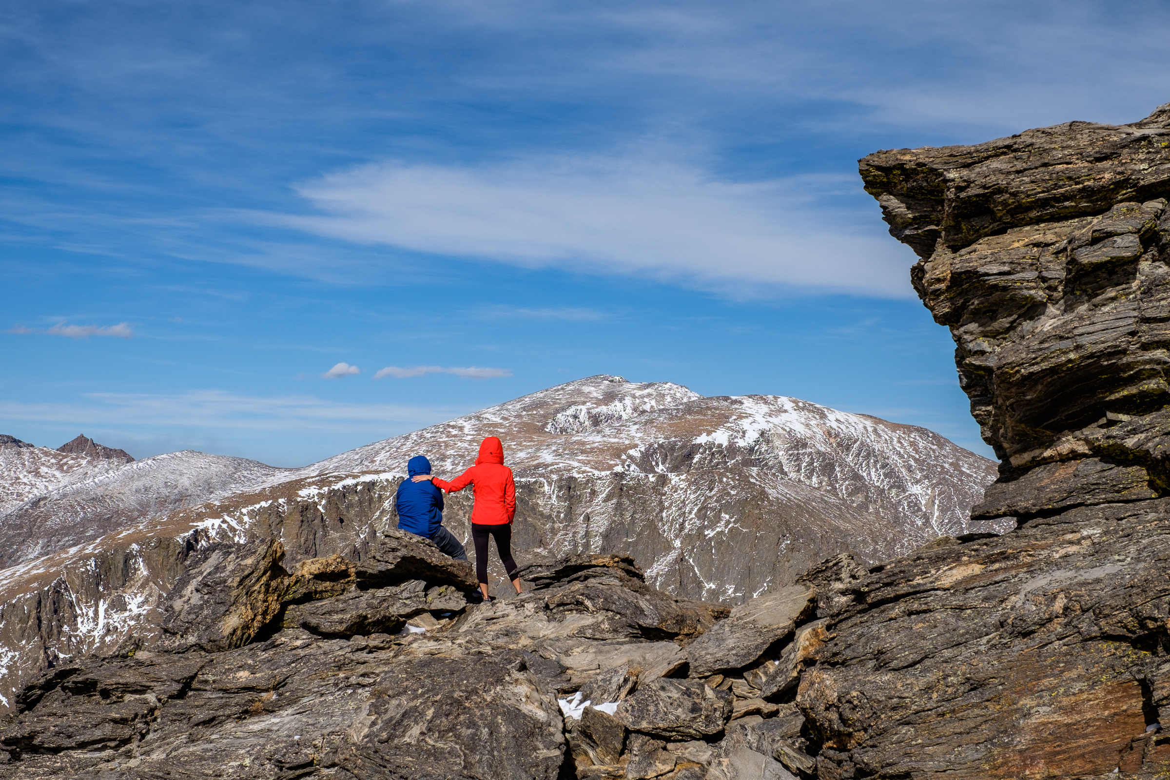 Friends stop on the Tundra Communities trail atop Trail Ridge Road to take it all in.