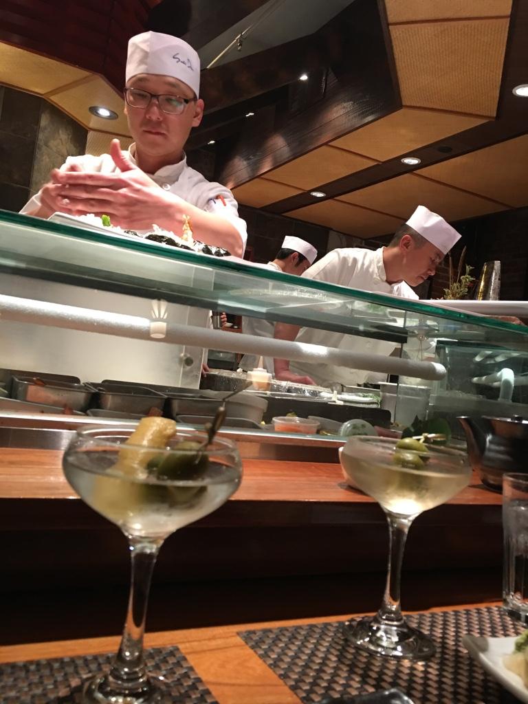 At the Sushi Den sushi bar watching the masters at work.