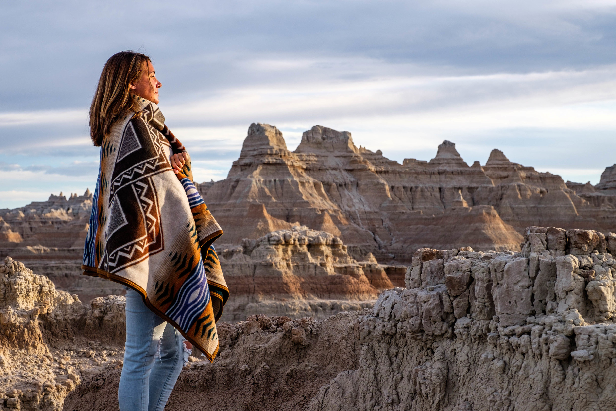 "Stefanie, with a small Lakota bloodline, looks out upon the badlands in her paternal grandmother's home state. ""I've never felt so connected to my family history,"" she said."