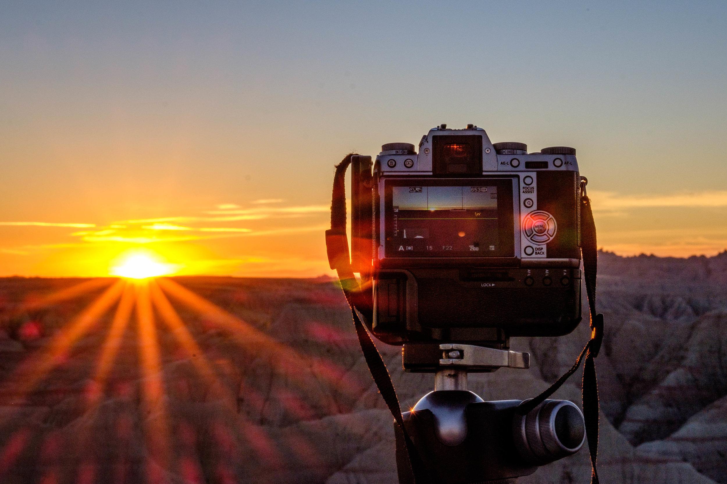 Catching the sunrise at Badlands National Park in South Dakota.