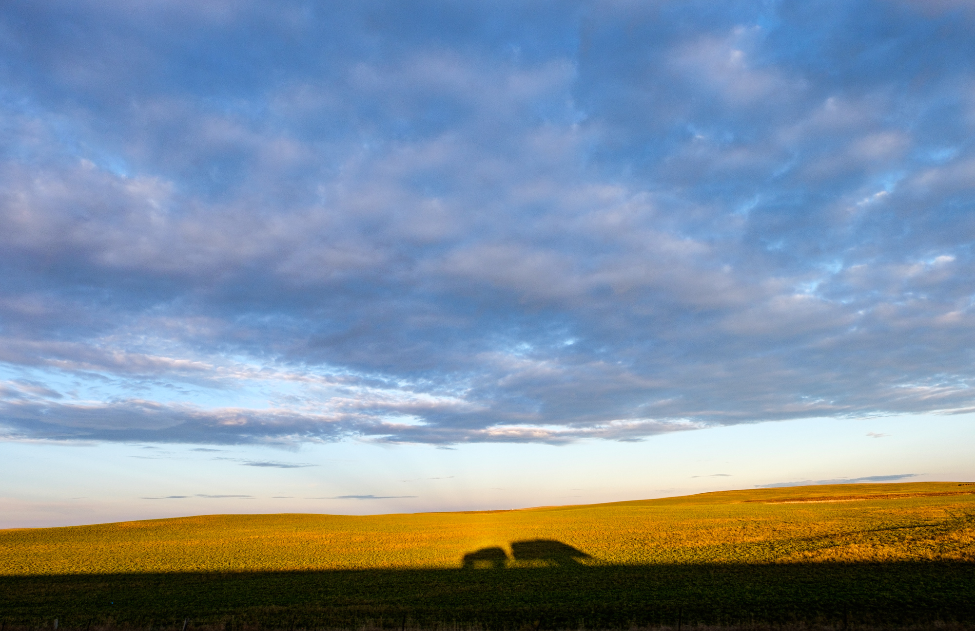 Shadow play with our Ford Expedition and Airstream against the rolling plains of North Dakota.