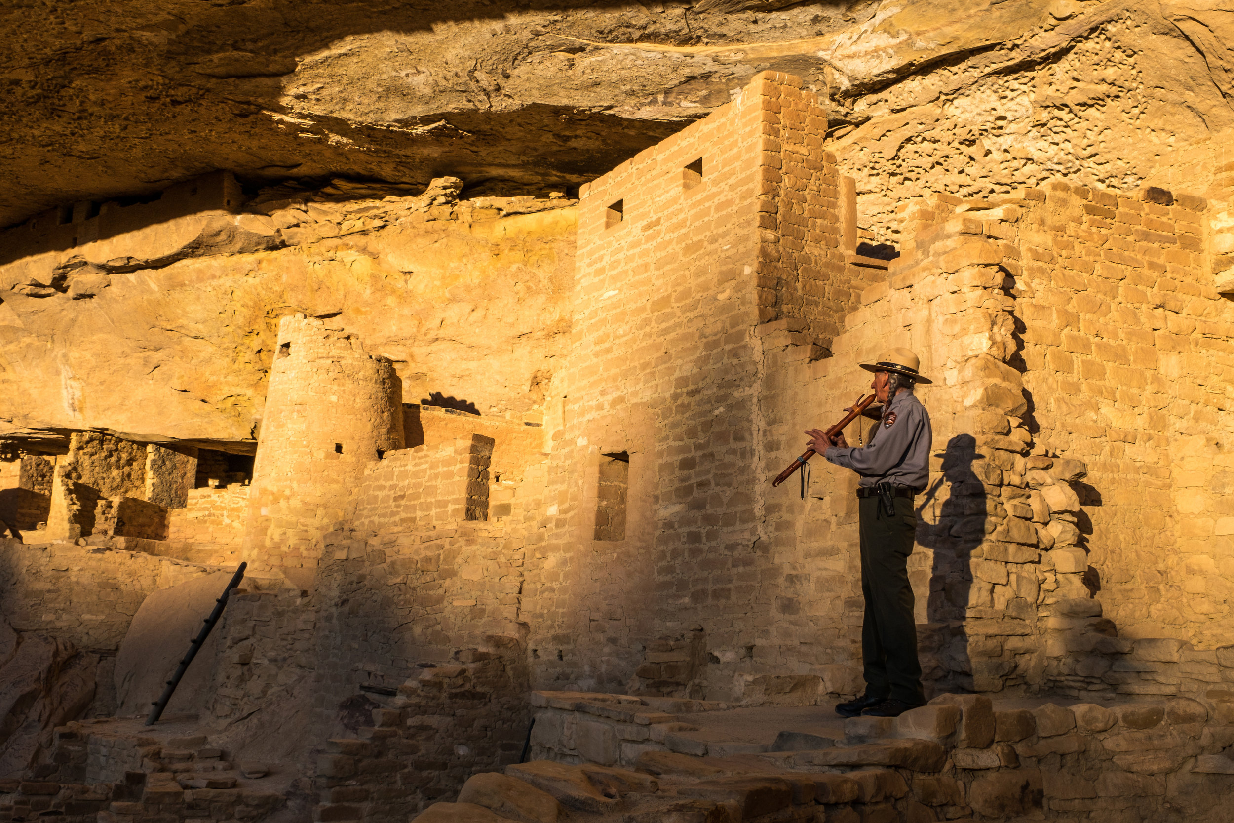 Park Ranger David Nighteagle offers a song to his ancestors inside Cliff Palace.