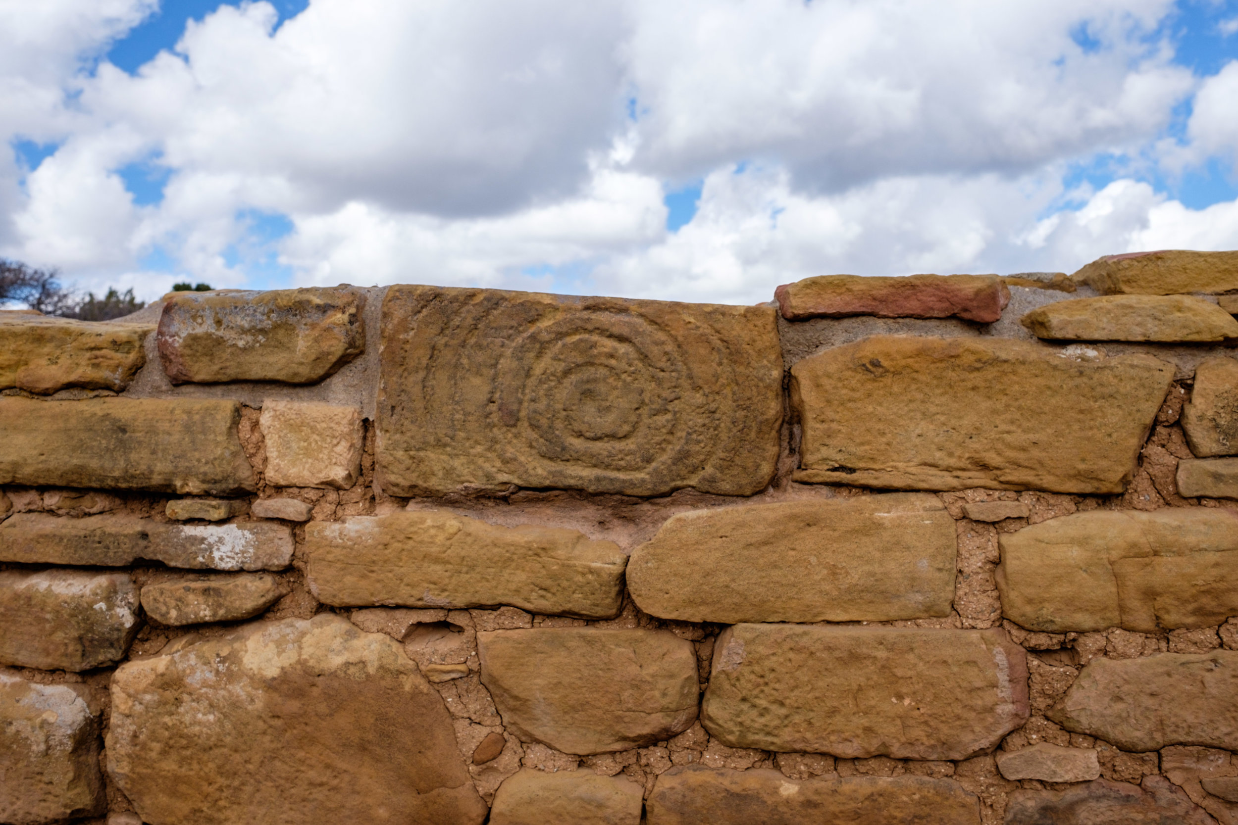Detail of a brick with an ancestral Peubloan design.