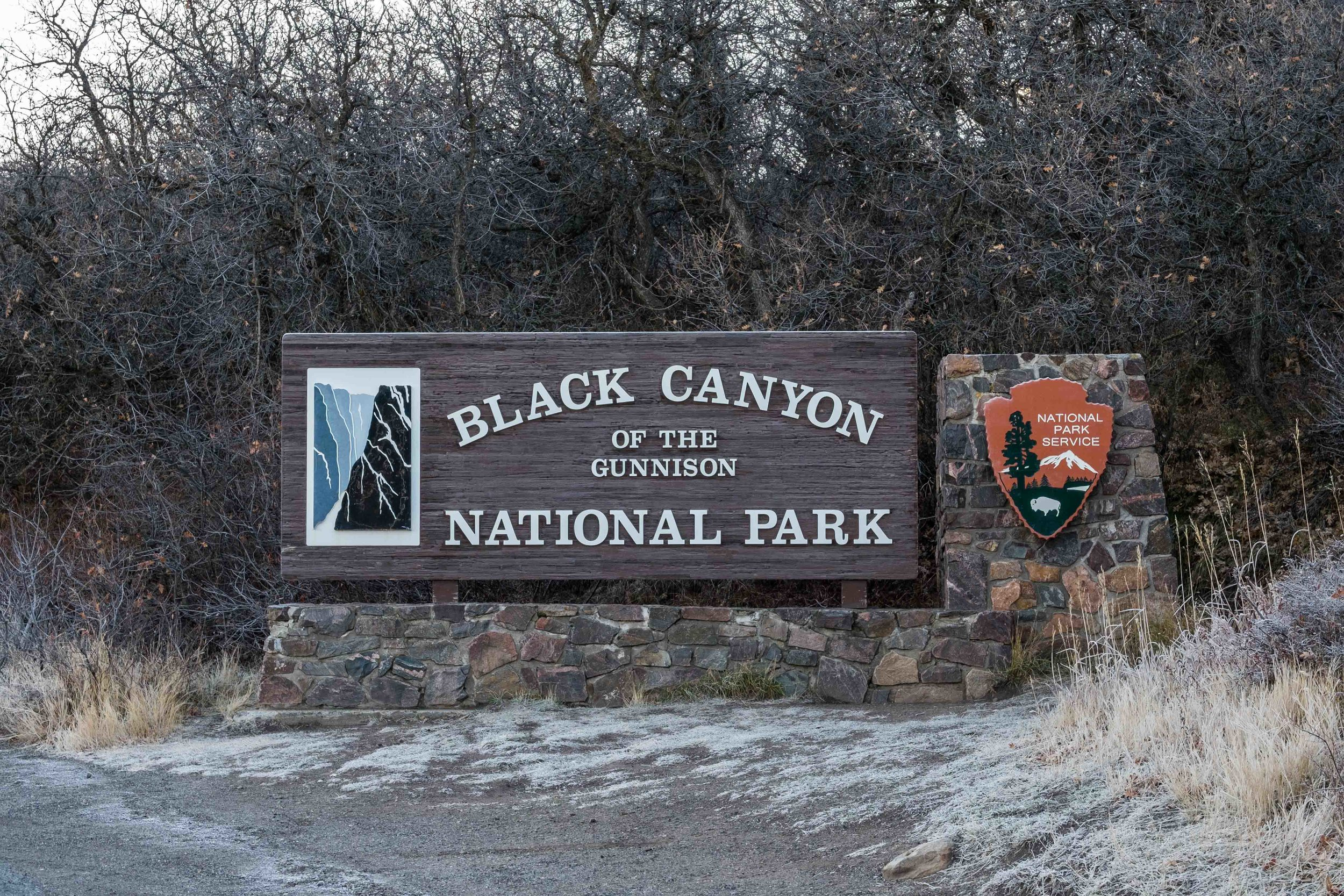 The park entrance sign to Black Canyon of the Gunnison National Park in Colorado.