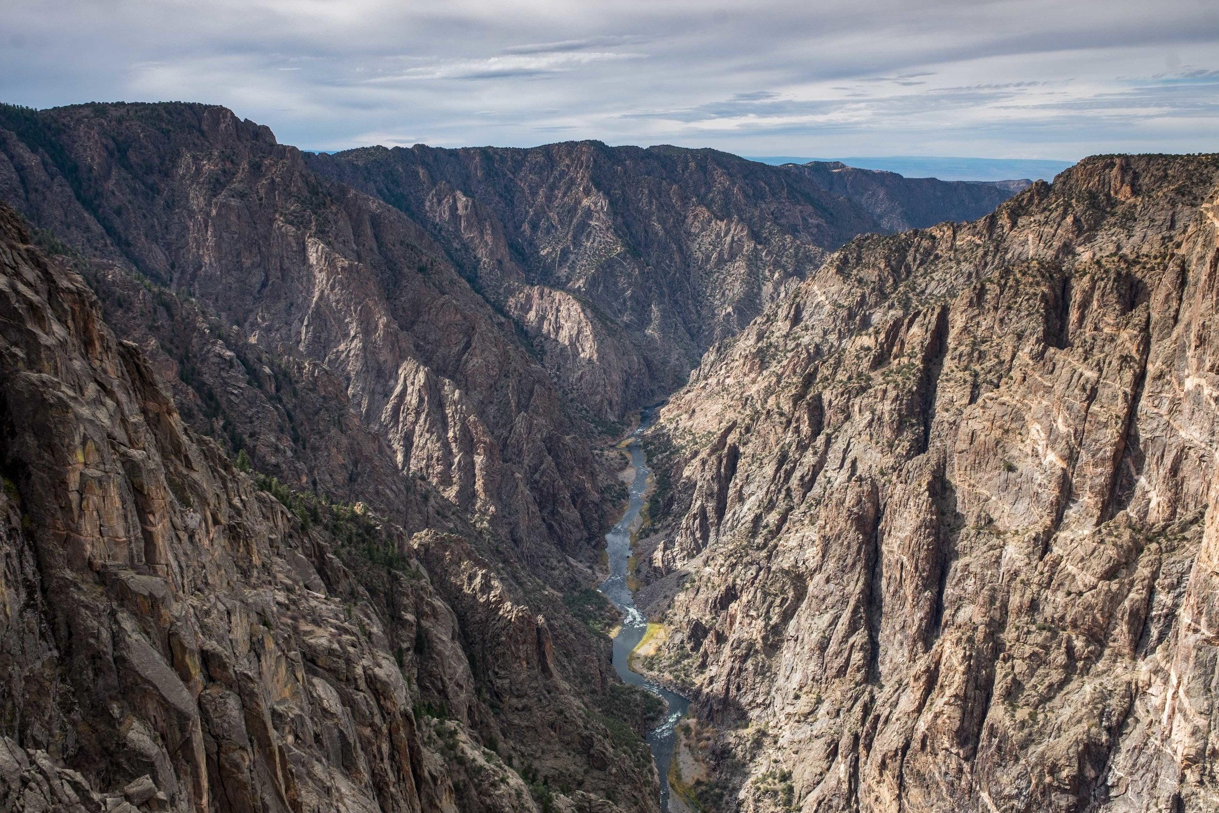Looking straight down the canyon walls to the Gunnison River below. Taken at Dragon Point, one of my favorite views in the entire canyon.