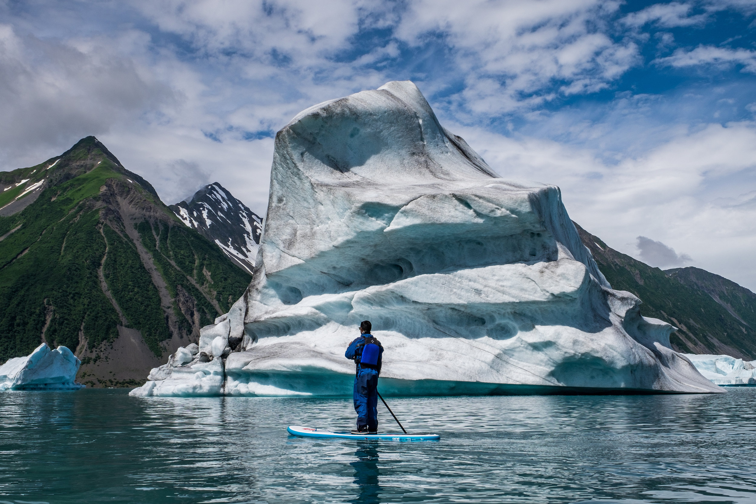 Stand up paddle with our new friends near Bear Glacier in Kenai Fjords National Park in Alaska. Credit: JONATHAN IRISH