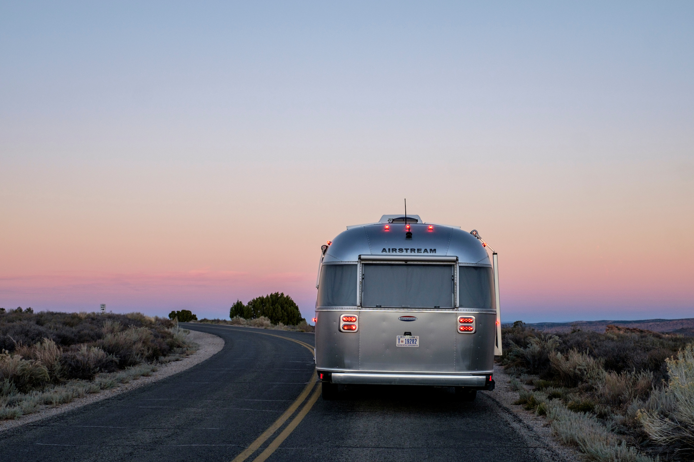 Wally the Airstream on the road in Arches National Park.