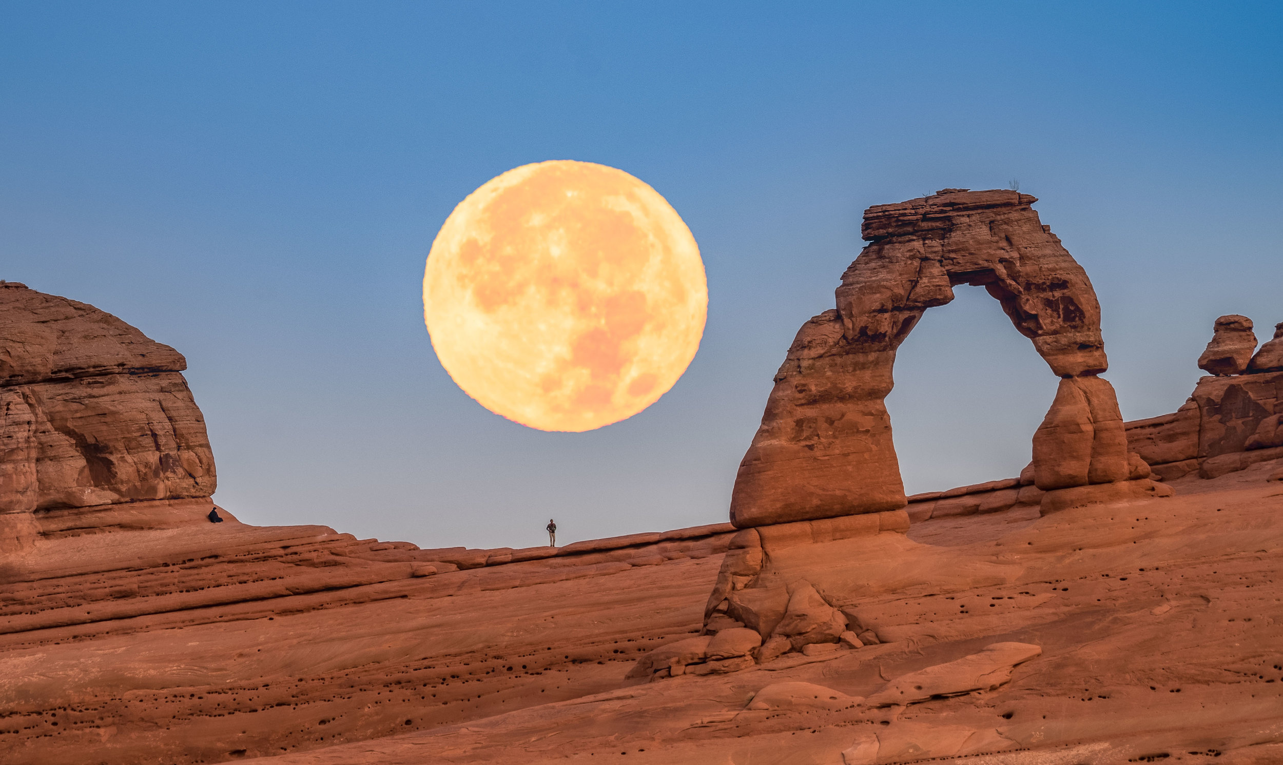 In-camera double exposure of supermoon over Delicate Arch.