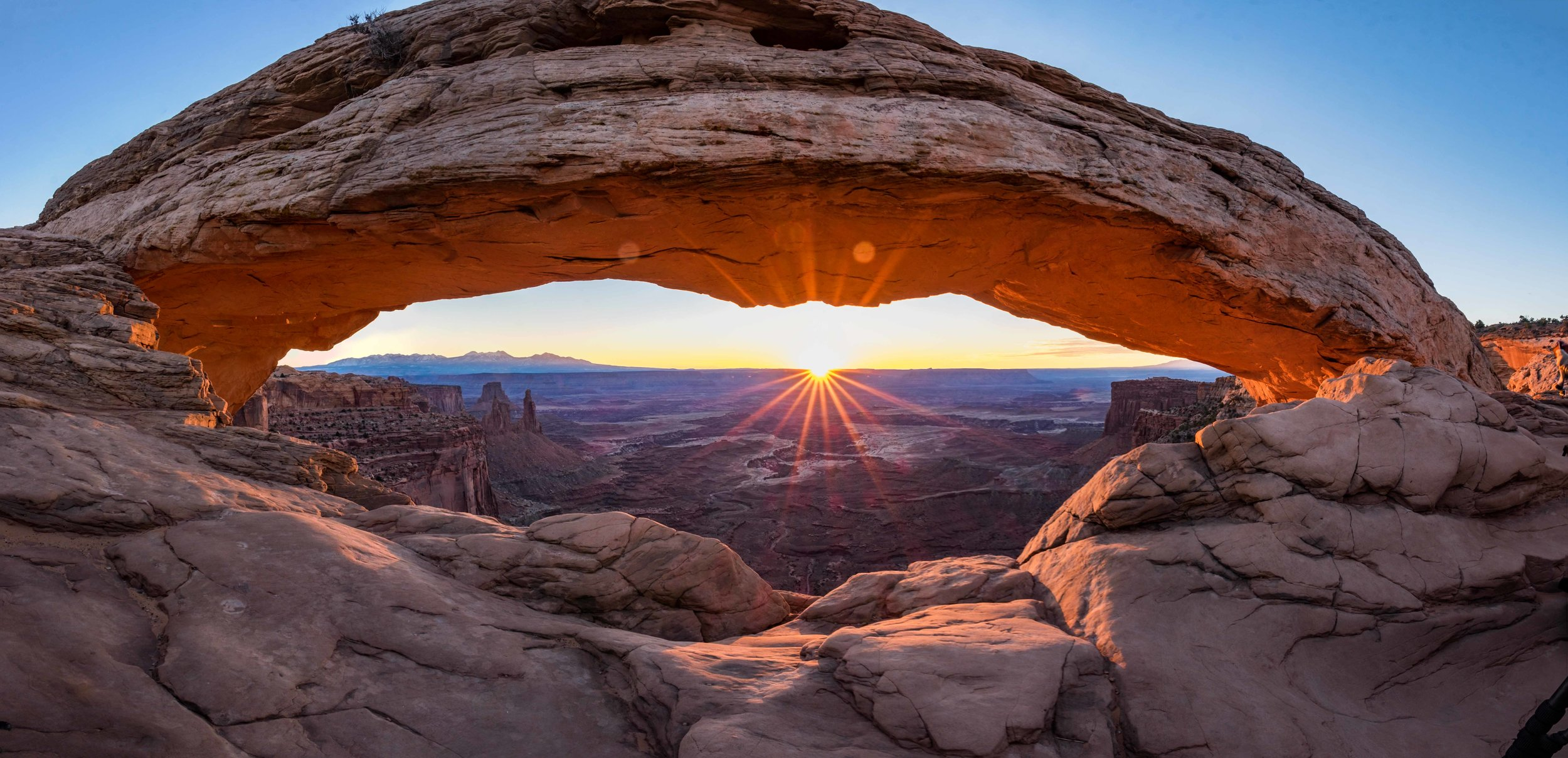 Panorama of Mesa Arch at sunrise.