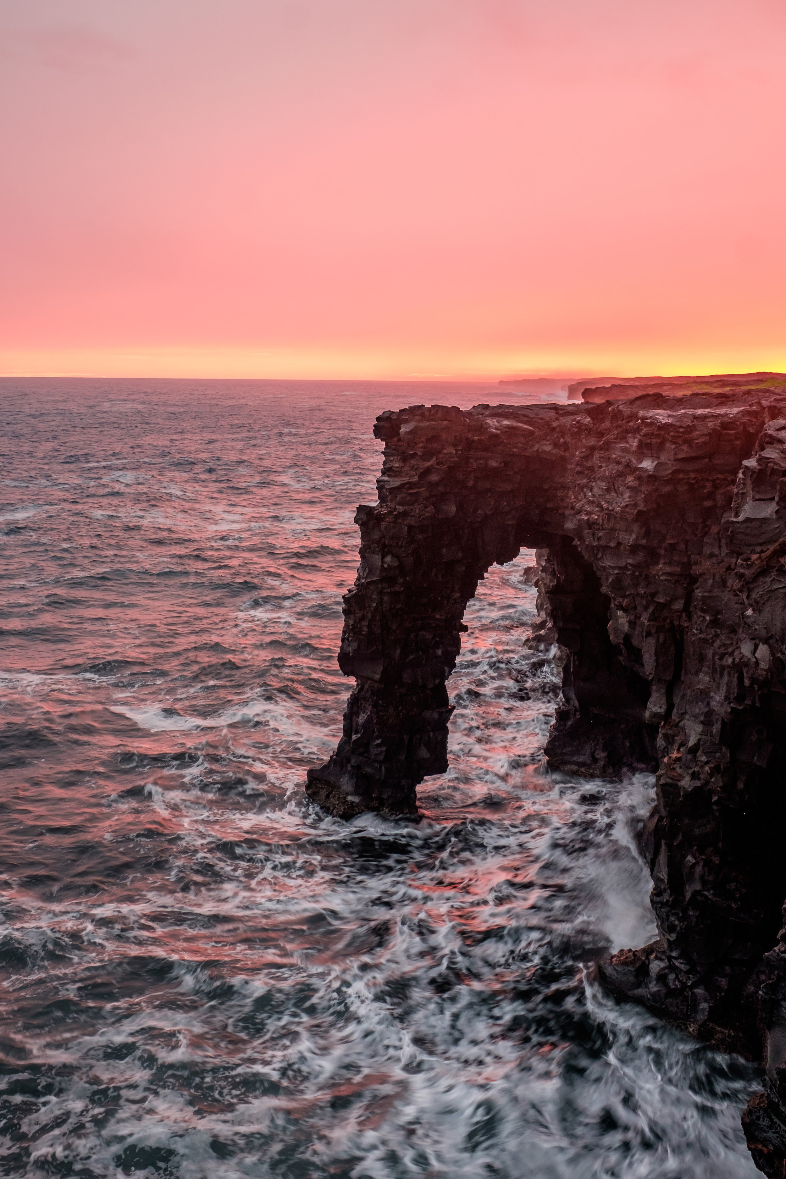 The Hōlei Sea Arch warmed at sunset.