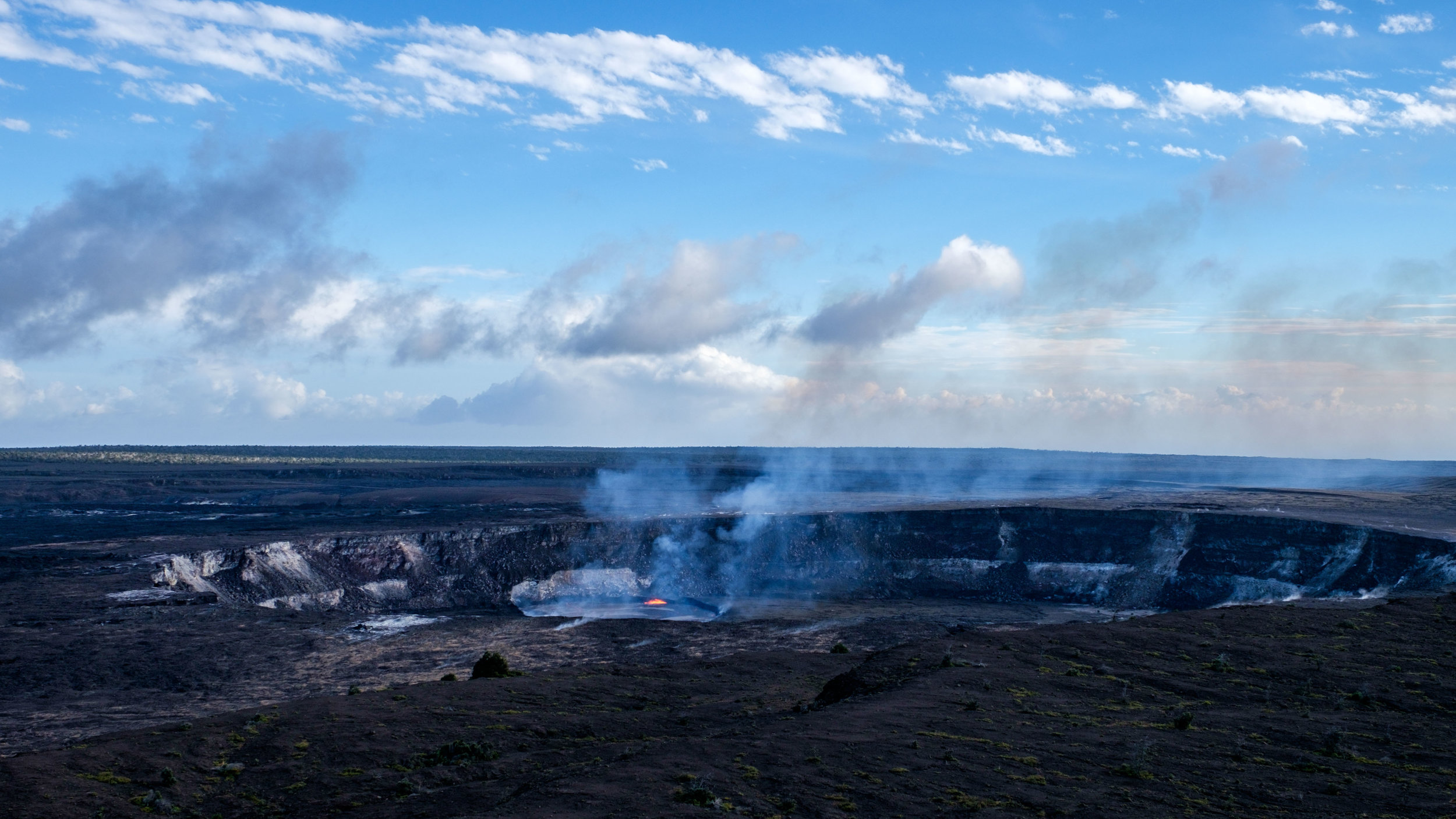 Halema'uma'u,Kīlauea's main crater   during the daytime as seen from the observation deck at the Jaggar Museum.