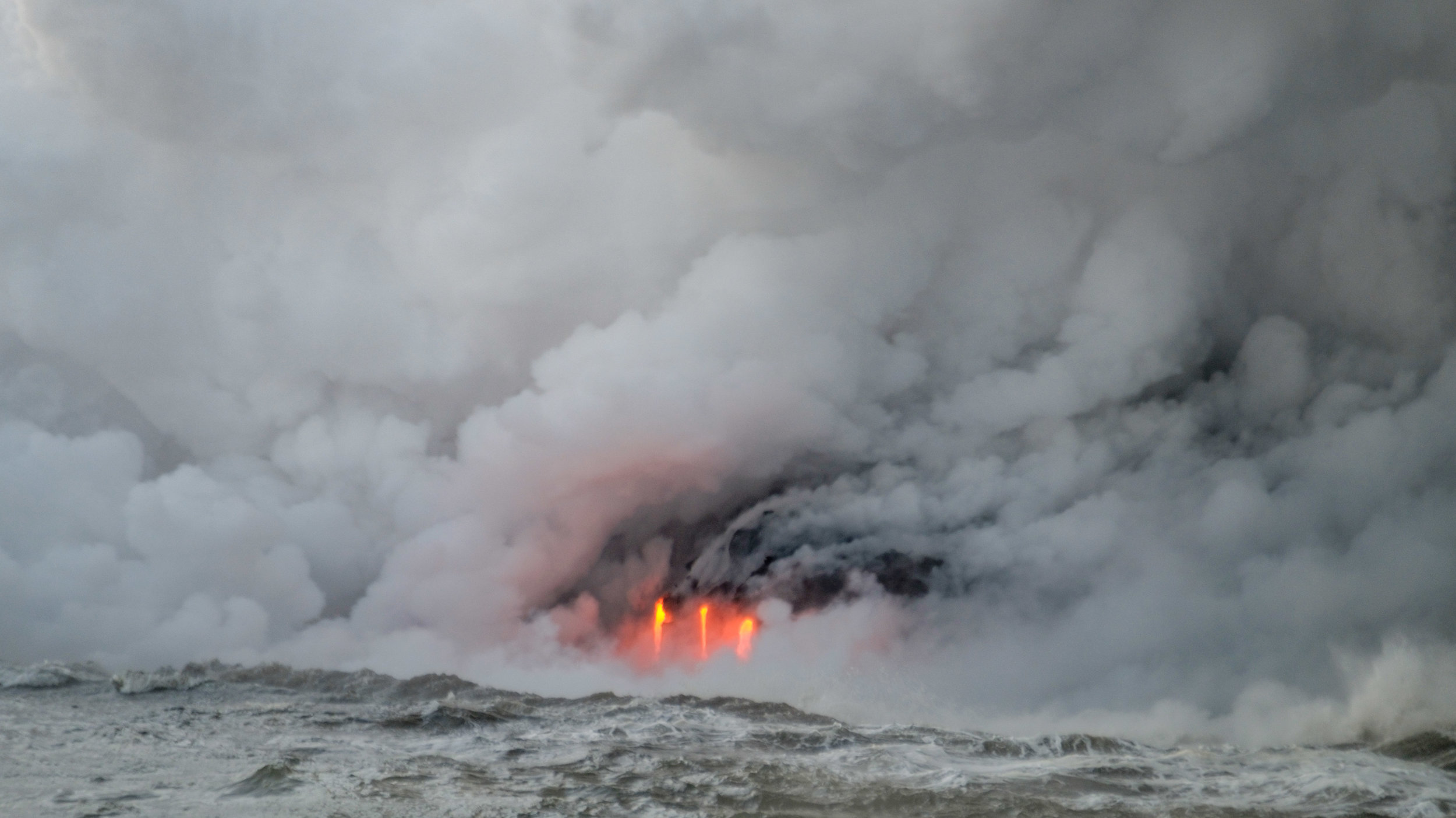 Lava meeting the icy Pacific Ocean.