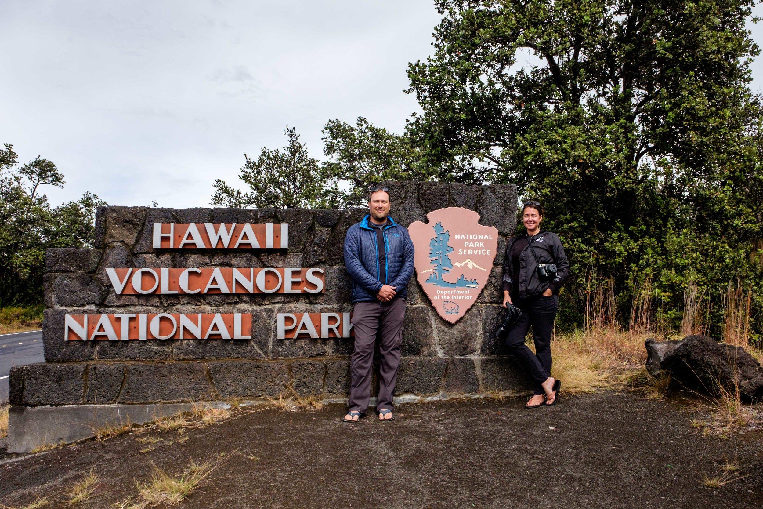 Jonathan Irish and Stefanie Payne at the Hawai'i Volcanoes National Park entrance sign.