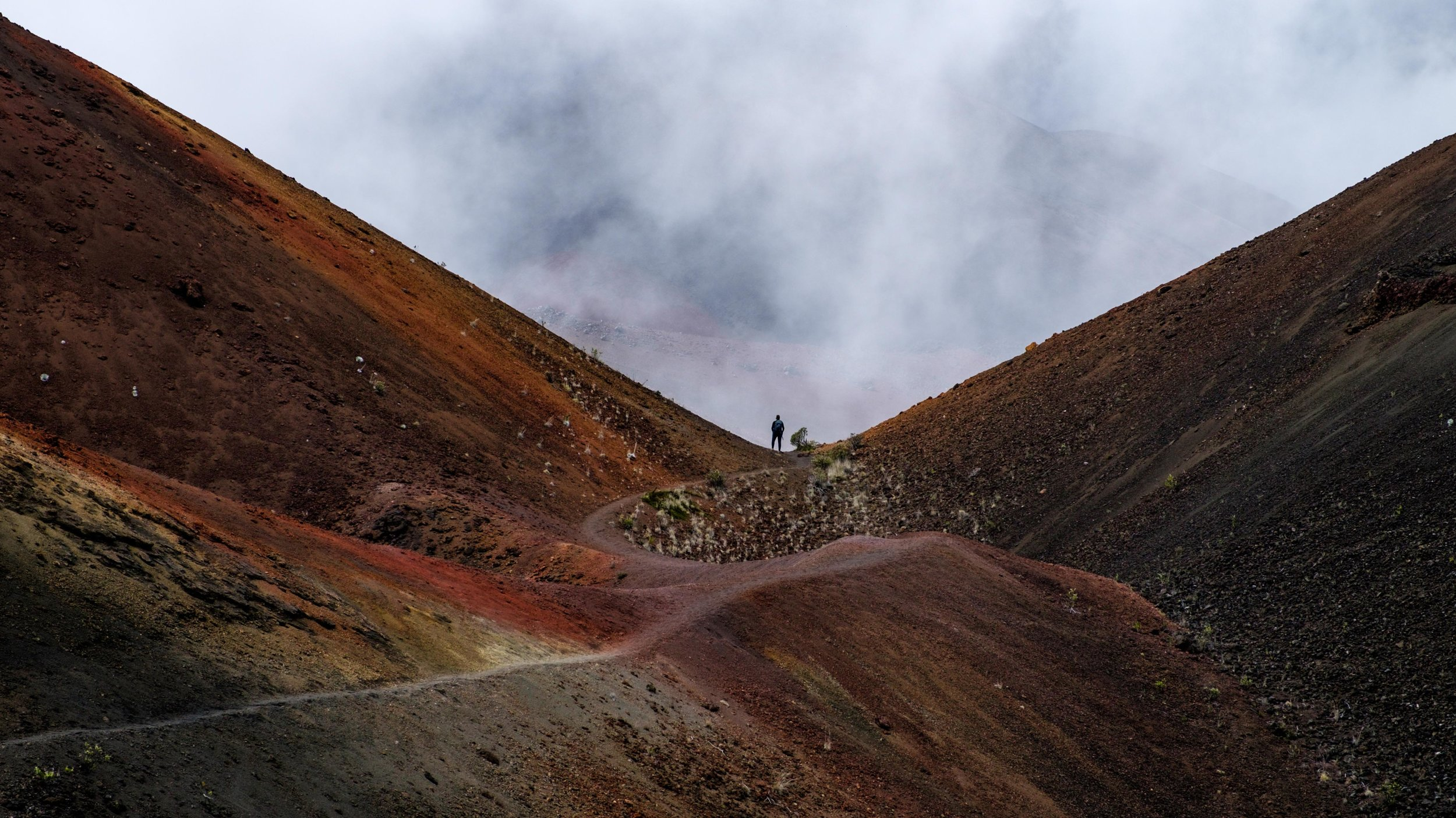 Surreal terrain washed with rich color on the cinder-cone landscape of the Haleakala Crater.