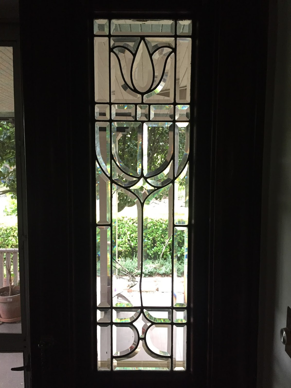 (Fortunately the damage to this beveled glass sidelight window was limited to the large middle portions, and we were able to reproduce them and repair the window)