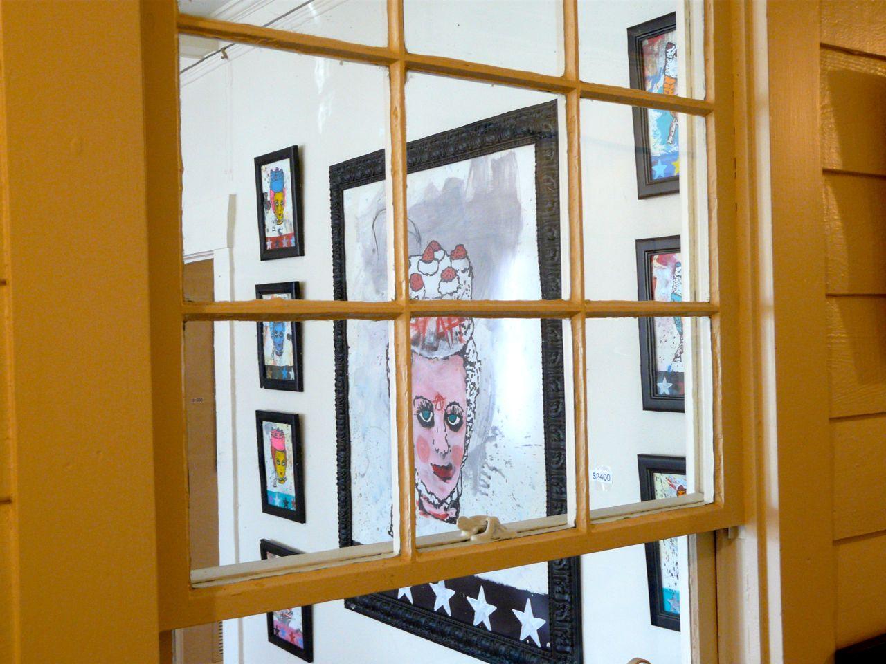 versus gallery interior through window art.jpg