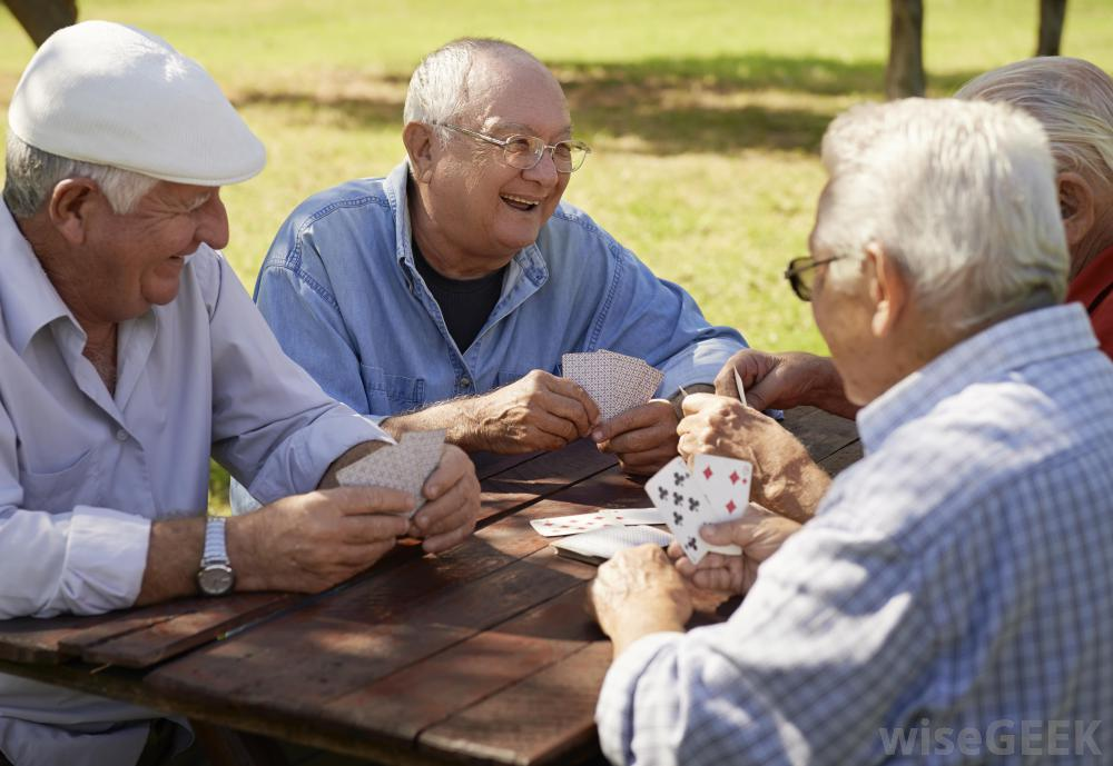old-men-sitting-at-wooden-table-playing-cards.jpg