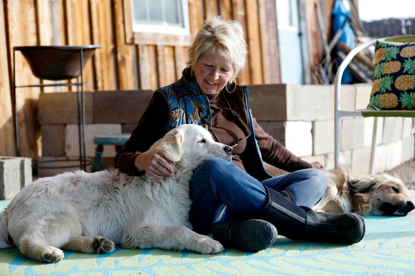 Debbie Faulkner shares a moment with her dogs that she has rescued at her ranch in Crawford, Colo. Faulkner is the owner of the Black Canyon Animal Sanctuary and founder of the Silver Whiskers program where senior pets are paired with senior citizens.