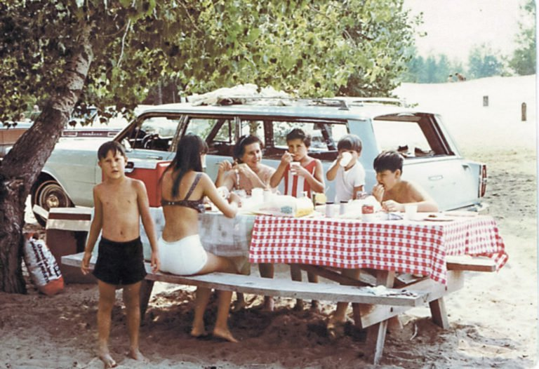 """""""Every Lyons family vacation began by packing the station wagon with children, coolers, and suitcases. We always stopped for lunch along the road—whenever my dad, Frank, spotted a picnic table,"""" says Susan Lyons Dietrich. """"Lunch was always the same: bologna sandwich, potato chips, and Kool-Aid.""""   COURTESY SUSAN LYONS DIETRICH/REMINISCE"""